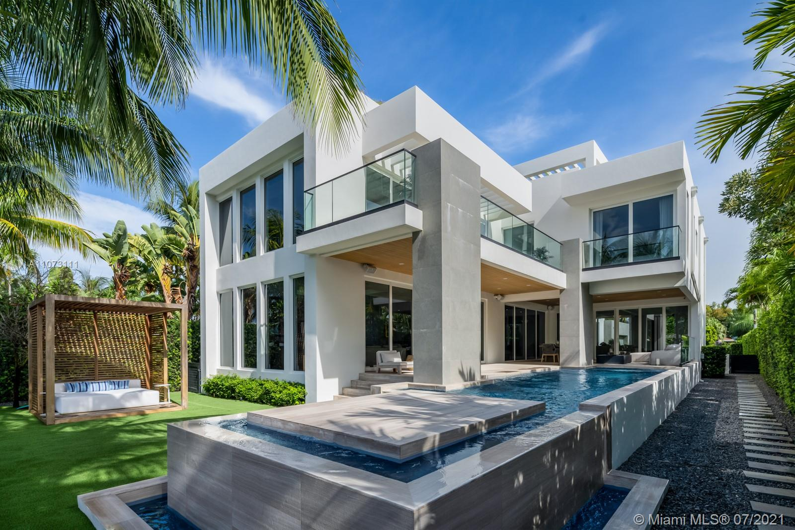 Located in the gated community of Normandy Isle, this custom built masterpiece offers 6,000 sf of meticulously crafted living space along with gorgeous finishes.  No detail was spared in the design of this home. 672 S Shore offers the highly sought after Miami lifestyle & was designed to blur the lines of indoor/outdoor living.  Inside the home you will find custom details including hand crafted cabinetry, tray ceilings, designer lighting, a full smart home including security cameras throughout, lighting, shades/drapes, surround sound speakers, thermostats, Dornbracht fixtures, custom closets, sand blasted marble floors, and a pivoting front door.  Outdoor living area has a spa, full summer kitchen with gas grill, ice maker, and fire pit.  Please contact agent for showings.