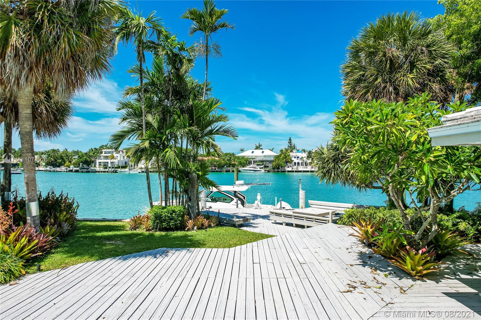 Ideal home for the waterfront enthusiast, boasting 104-feet of water frontage with an unobstructed view of the Miami Skyline. 15,000+ SF lot located in one of Key Biscayne's most desirable waterways, Hurricane Harbor.  The house is situated on the widest part of the protected harbor and features a boat Davits and an oversized extended dock over the water - a boater's dream. Fantastic opportunity to transform this spacious home or build a tropical dream home on North Mashta Island. Living areas include 4BR/4BA plus staff quarters, two dens, separate dining and living room. Exterior features include covered patio, heated swimming pool. Seller is a developer and may provide complete Architectual plans for remodeling the house or construction of new home.
