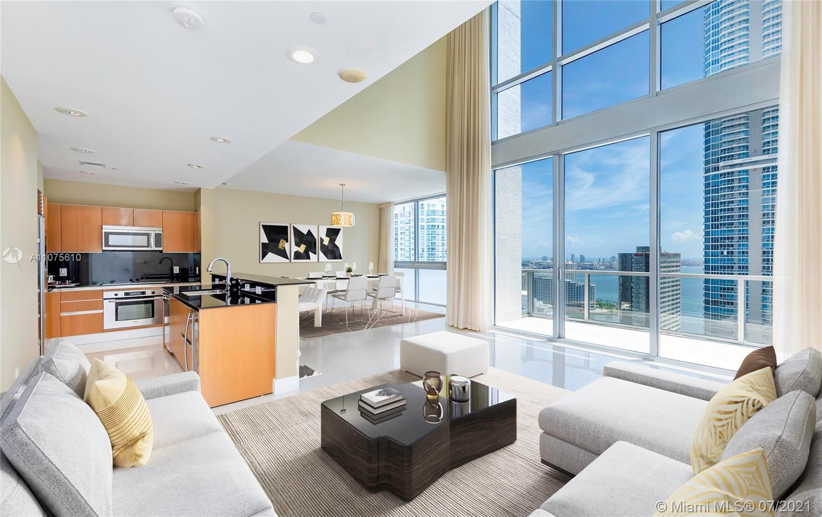 Beautiful two-story Penthouse on Brickell Avenue. Spacious floor plan which spans both the upper 34th & 35th floors. Interior features include an elegantly designed residence that boast breathtaking  bay views, towering high celling in living room, second floor split-bedroom plan plus living area, and a deep awareness of seamlessly connected living. Though the beauty of this two-story Penthouse is undeniable, it is also the myriad of thoughtful amenities that makes 1050 Brickell unforgettable. Amenities include 24-hour security and concierge, valet, fitness center, swimming pool, sundeck, game room with billiards table, yoga room, steam room, jacuzzi, spa, virtual golf room, wine lounge, and much more. Close to great shopping, fine dining and financial center. You will love coming home !