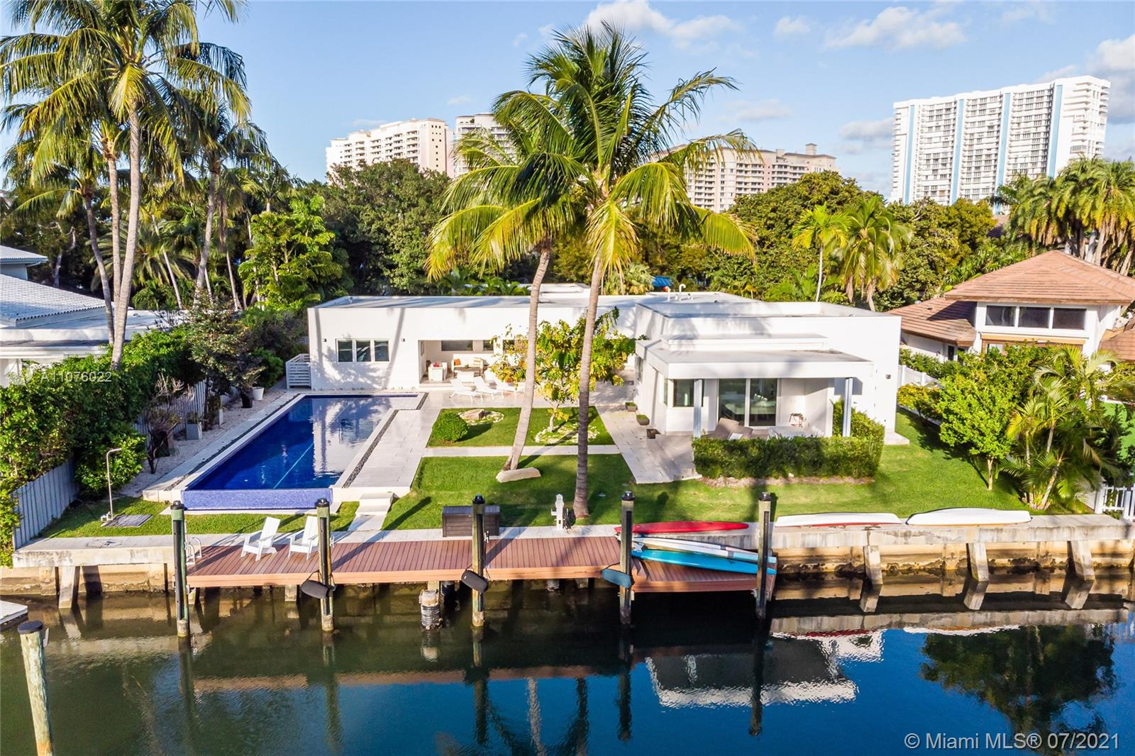 Boater's dream modern haven right on the water! Brand new 4BD/4.5BA one-story home located in one of Key Biscayne's most desirable waterways. House sits on 15,000SF Lot with lot size of 100x150 with a 120ft sea wall & direct ocean access. Enjoy breathtaking Sunset Skies from every room. Formal dining and living room open directly to covered patio area overlooking beautiful blue-tiled Lap Pool & the waterway. Kitchen features snack-bar counter, Miele & Viking Gas Appliances & wine coolers. High-Impact windows & window treatments throughout; black-outs in bedrooms. Two oversized & spacious Master Suites; all bedrooms en-suite. Large pantry area including laundry room. Beautiful & fine modern finishes. Perfect for entertaining & enjoying living life on the water