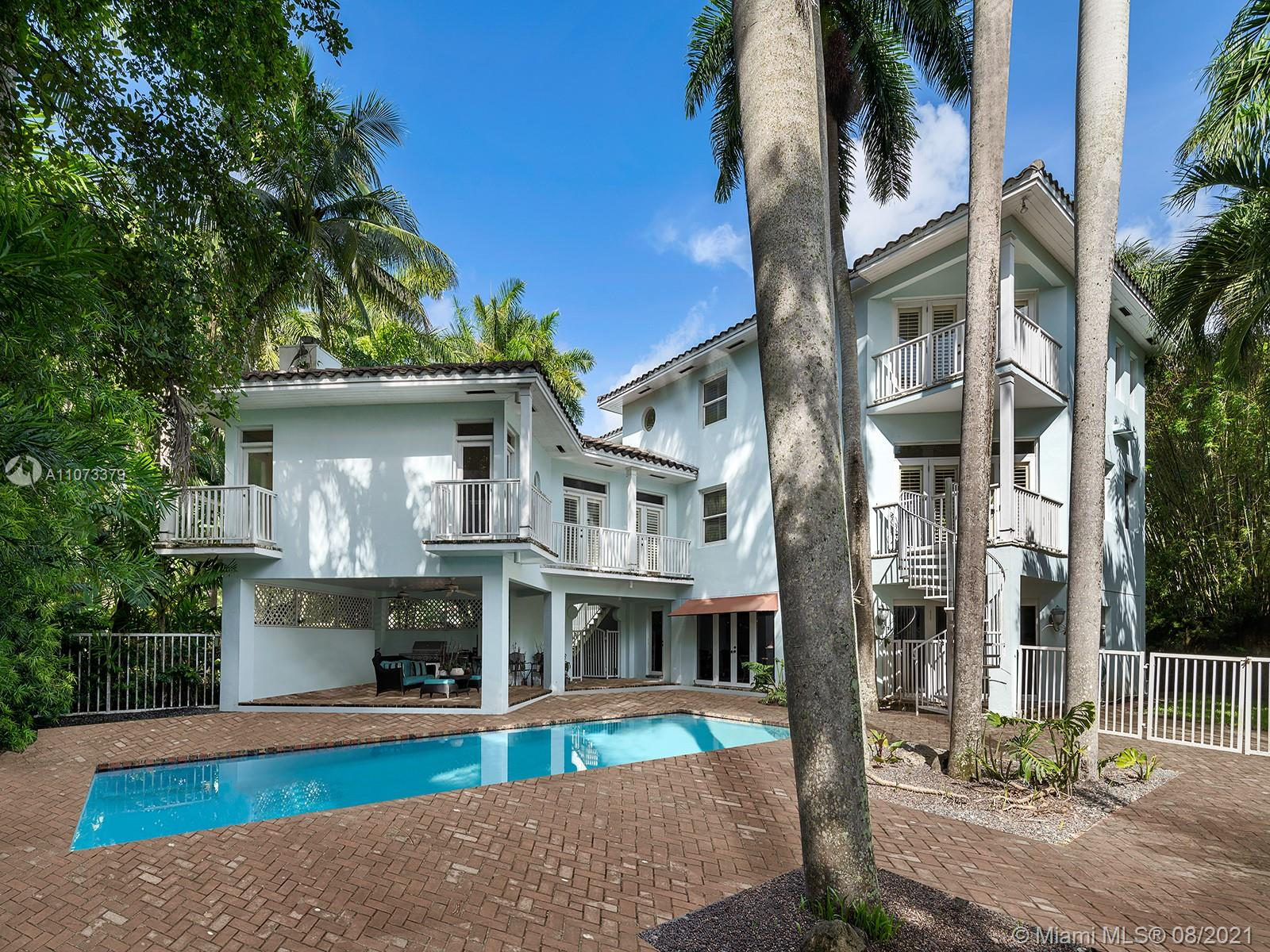 Located along a private, guard gated street in Coconut Grove known as the Anchorage, Reef Haven is a three-story home just a few blocks from Cocowalk with spectacular shopping and dining in the famed heart of the Grove. You enter into the double-height gallery on the main level, offering a cupola with portholes, and as you explore the home you're presented with over 10 balconies facing every direction. With vaulted ceilings throughout, the 6,000 square foot house offers a variety of gathering spaces, including formal living and dining rooms, a recreation room off the pool and lanai, and an impressively large office. Each space has beautiful light throughout. Renovate or rebuild to create the home of your dreams, and take advantage of the excellent bones the existing house provides.