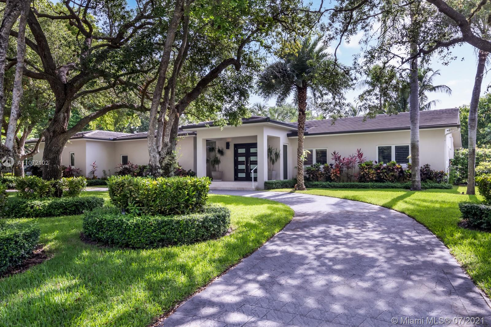 This beautiful home is located on a quiet Pinecrest street offering 4 beds, an office and 4.5 bath. The 4,798 Sf home was renovated in '15 and sits on almost an acre of lot. The property offers wood and marble floors, high ceiling, large en-suite bedrooms, Thermador appliances & gas range. The split floor plan provides for two master bedrooms w/private access to the backyard & pool. The property features a large elegant entrance, a separate living and family room as well as a large kitchen w/island and lots of natural light. The very private exterior of the property provides for a salt water pool, lush landscaping, plenty of green space, 16 types of fruit trees and a coverage terrace. Finally this home comes with 2-car garage and is located in the Pinecrest school district.