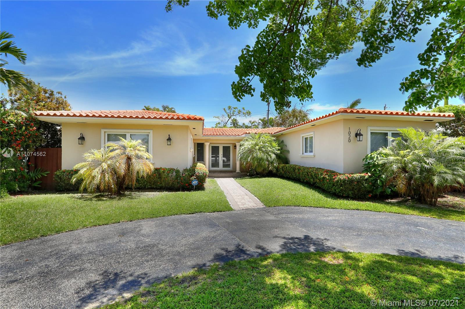 Located in gated Normandy Shores Island & near the Beach & Normandy Shore's Golf Club, this home has been  totally remodeled in the last 6 years! W/ over 2,400 sq. ft under air, this 3 BEDS/ 3 BATHS + DEN features a grand family room, marble floors throughout, private master suite that opens up to the tropical yard, Impact W + Ds, 6-year-old roof, updated plumbing + electrical & newer AC. W/ a state-of-the art kitchen and a private yard w/ room for a pool, this home is perfect for entertaining and to host a nice family gathering! W/ walking distance to all the fantastic amenities the Island has to offer incl. the golf course, tennis & basketball courts, soccer field, kid's playground, gym & clubhouse w/ bar & restaurant. Property is also available for rent at $8,000/month.