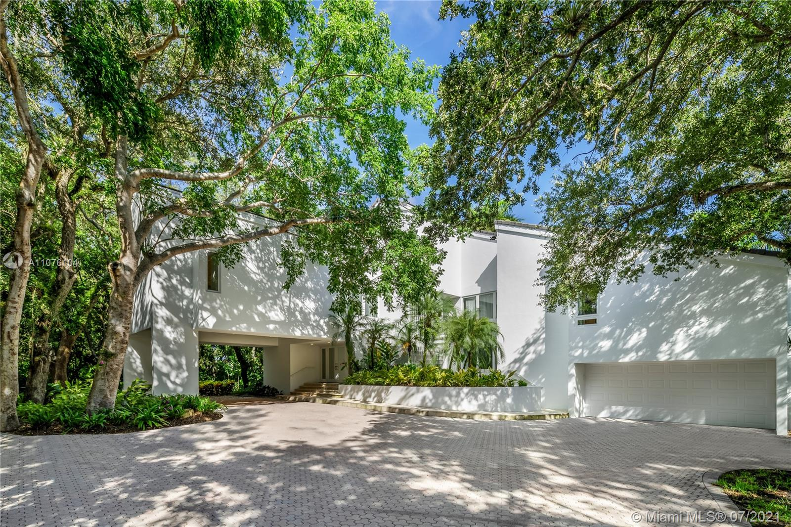 A contemporary 5,297 sq ft house sits on an impressive 1.4 acres filled with lush gardens and large oak trees. This bright, freshly-painted and spacious home offers high ceilings, impact windows and doors throughout with 5 bedrooms and 6.5 bathrooms. The perfect split plan with all bedrooms located on the 2nd floor. The two large decks and large, beautiful pool make this house the perfect home for entertaining. Roof is 2015. Home is part of the Gables Estates Club and membership approval is a pre-requisite to purchase.