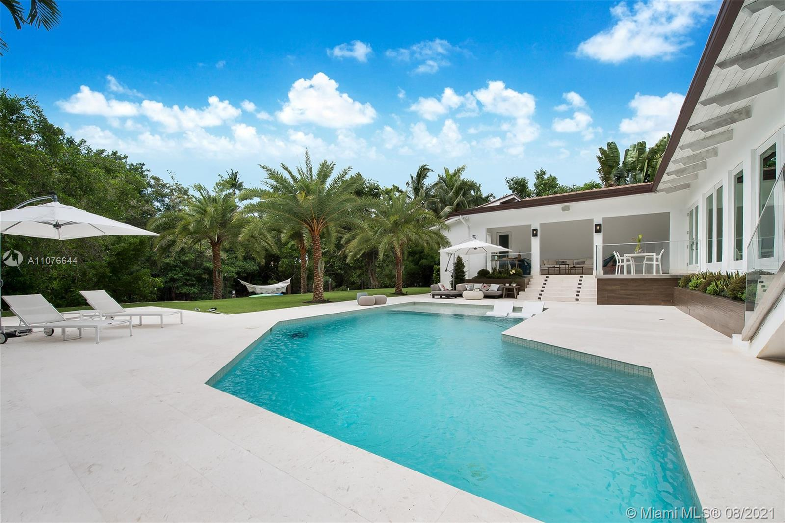 Newly renovated waterfront home nested in the gorgeous gated community of Cocoplum. This luxurious home includes 5 bedrooms, 6.5 bathrooms, 2 separate rooms for office and/or family use, with marble flooring throughout. The main bedroom offers private access to a beautiful outdoor space and pool. The gas stove kitchen boasts top of the line appliances, a spacious breakfast area and custom-made cabinets. An enclosed 2 car garage and 80 foot dock are sure to please the most passionate car and boat enthusiasts. Located within a ten minute drive of the best schools in Miami, gourmet restaurants and live entertainment, this waterfront property is the ideal family home while offering the best entertainment Miami has to offer and direct access to the open seas.