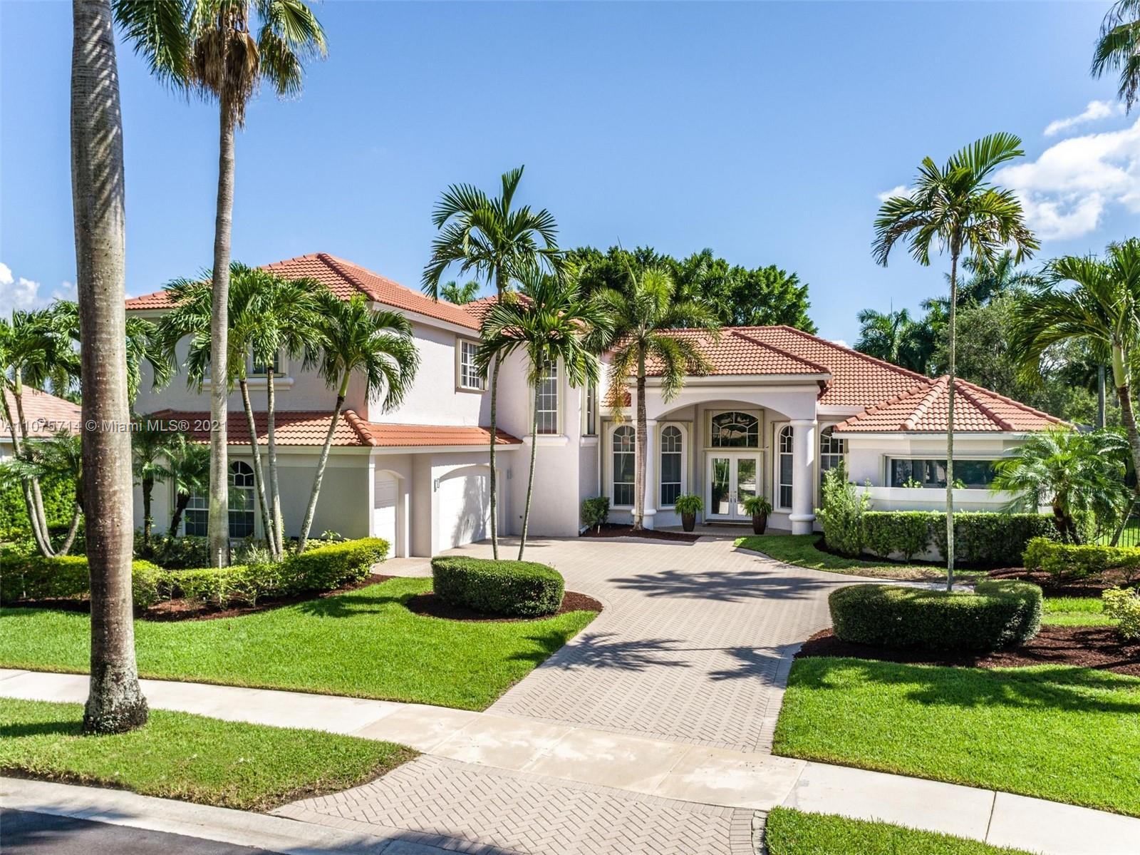 GOLF,GOLF,GOLF..This Exquisite 5,507 SF. Home Rests On a Lot of Approximate half an acre. It Features 5 En-Suite Bedrooms, 5.5 Deluxe Remodeled Bathrooms & An Upscale New Kitchen (2019). The Master Bedroom & its Sumptuous Spa-Inspired Master Bath Is Located In Ground Floor & A Second/Guest Bedroom. Richly-appointed spaces include modern office, a 2021 Bar/living Entertainment Area With A Glass Wine Cellar (400 bottles) & New appliances. Italian Tiles 32x32 & Laminate floors. New Roof 2019. The Spacious Breakfast Area Overlooks The Fully Fenced Backyard & Recently Resurfaced Pool (2021). Enjoy 4-Hole Golf Verdant Surroundings while BBQing in the Built-in Summer Kitchen. Accordion Shutters Throughout, 3 New AC (2019), Ample Driveway, 3-Car garage. BRAND NEW HOME in Weston Hills Country Club!