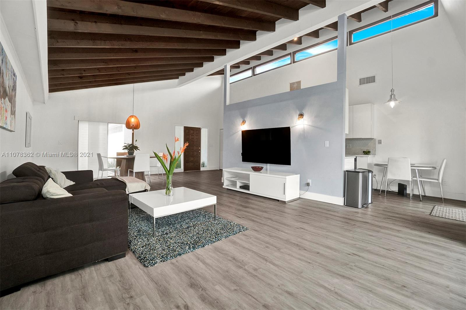 ONE-STORY VILLA COMPLETELY REMODELED WITH OPEN CONCEPT. VAULTED CEILING IN THE LIVING AREA WITH EXPOSED WOOD BEAMS GIVING A BIT OF CHARM. LOTS OF NATURAL  COMING THRU   WITH A BEAUTIFUL VIEW OF THE GOLF COURSE.  THERE IS A INSIDE LAUNDRY ROOM. 2 CAR GARAGE.