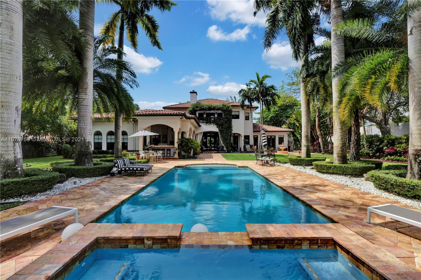 This elegant and sophisticated European Transitional masterpiece sits on a rare deep acre lot. This beautiful Pinecrest home is surrounded by a beautifully manicured botanical garden, created by Jungle B's landscapers from Homestead. You will find that this 6 Bed. /5.1 Bath, home utilizes its 6,613 sq. ft. of living area in a very useful and elegant manner. Every bit of space serves a valuable purpose, and no living area goes to waste. This home is great for your family to enjoy, and fantastic for you to entertain your guests. Indoor garage for 3 cars. This property also comes with a brand new stand-by home generator that will power your entire home for days. Walking distance to all three A-Rated Palmetto schools, less than a ten-minute drive to most top private schools in the area.