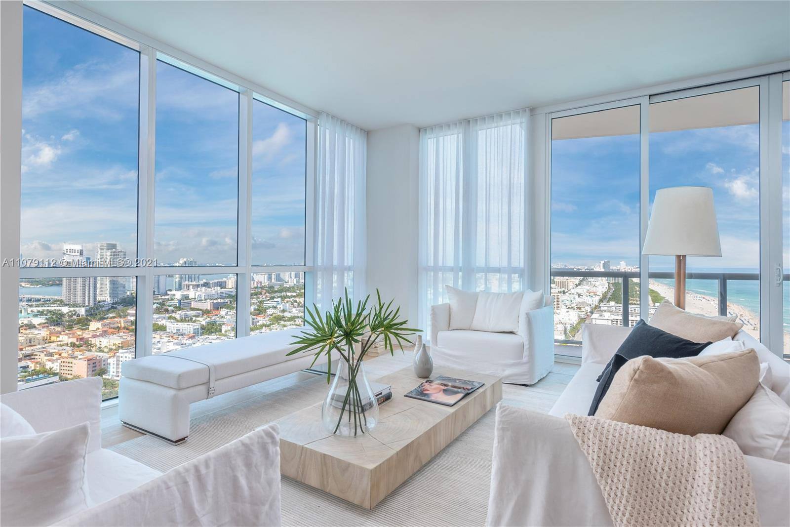 This rarely available high-floor corner unit offers incredible natural light and unobstructed views of the Atlantic Ocean, Biscayne Bay and downtown Miami.  Owners will enjoy a spacious, open-floorpan with extra-large living room, four balconies, private elevator lobby and all of the benefits of a tasteful renovation (completed in 2017).  Call listing agent today!  This condo won't last.