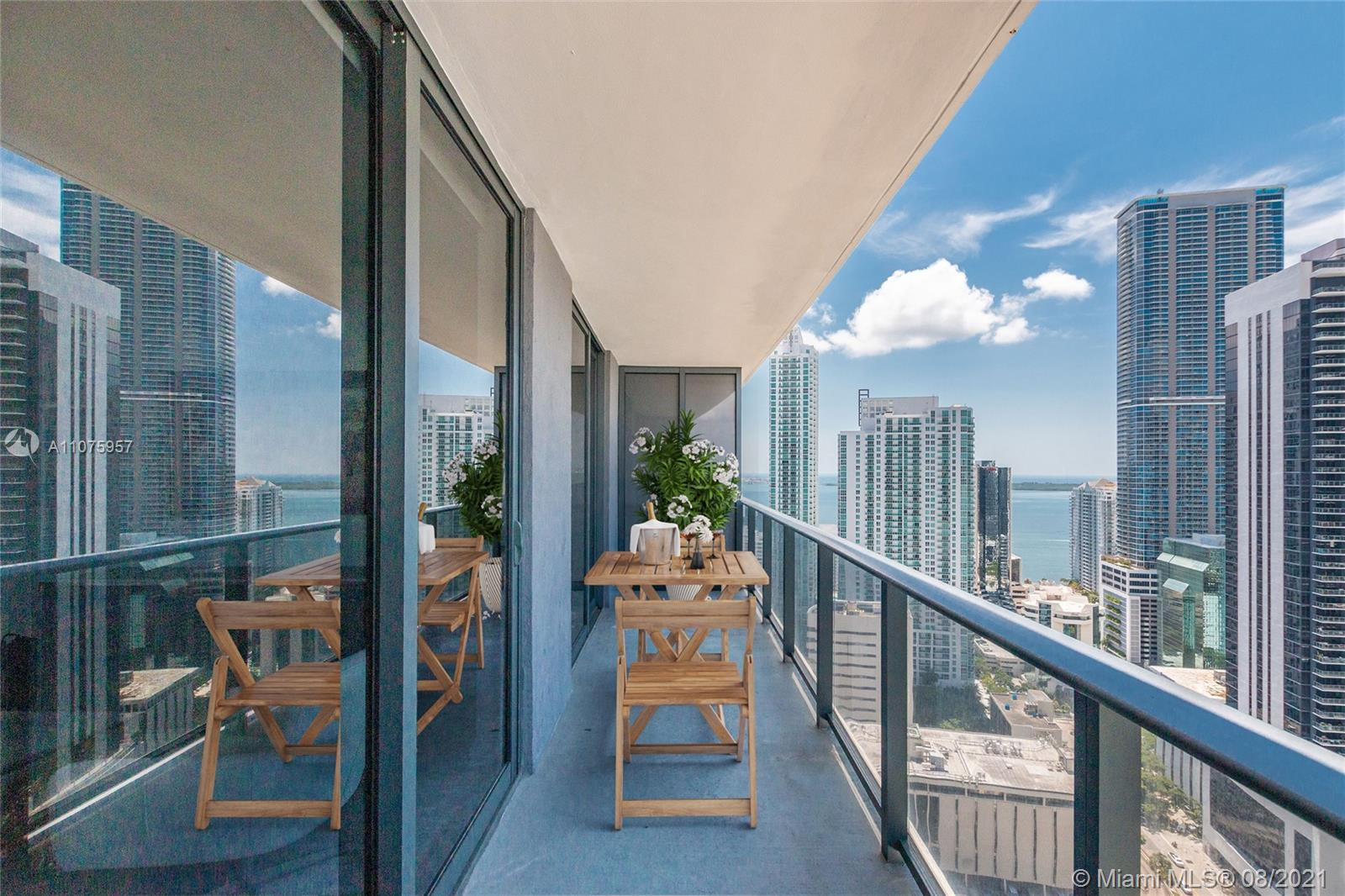 A modern condo in the heart of Brickell, with a panoramic view of the Miami Skyline and Biscayne Bay from the large terrace or the spacious bedroom and the living room & dining area.  The unit is in the stunning Brickell Heights East, walking distance to Brickell City Center, Publix supermarket, restaurants, and the Underline. Amenities include: spectacular rooftop pool, home theater, entertainment & party rooms, spa, a well-equipped fitness center, children's playroom, conference room; 24-hr Concierge; ample HOA reserves. The den can be used as a home office or converted to a second bedroom. Upgrades include cabinetry from the Closet Factory, built-in shelves in the walk-in closet, and a new large capacity washer/dryer; one valet parking space & additional car valet for a monthly fee.