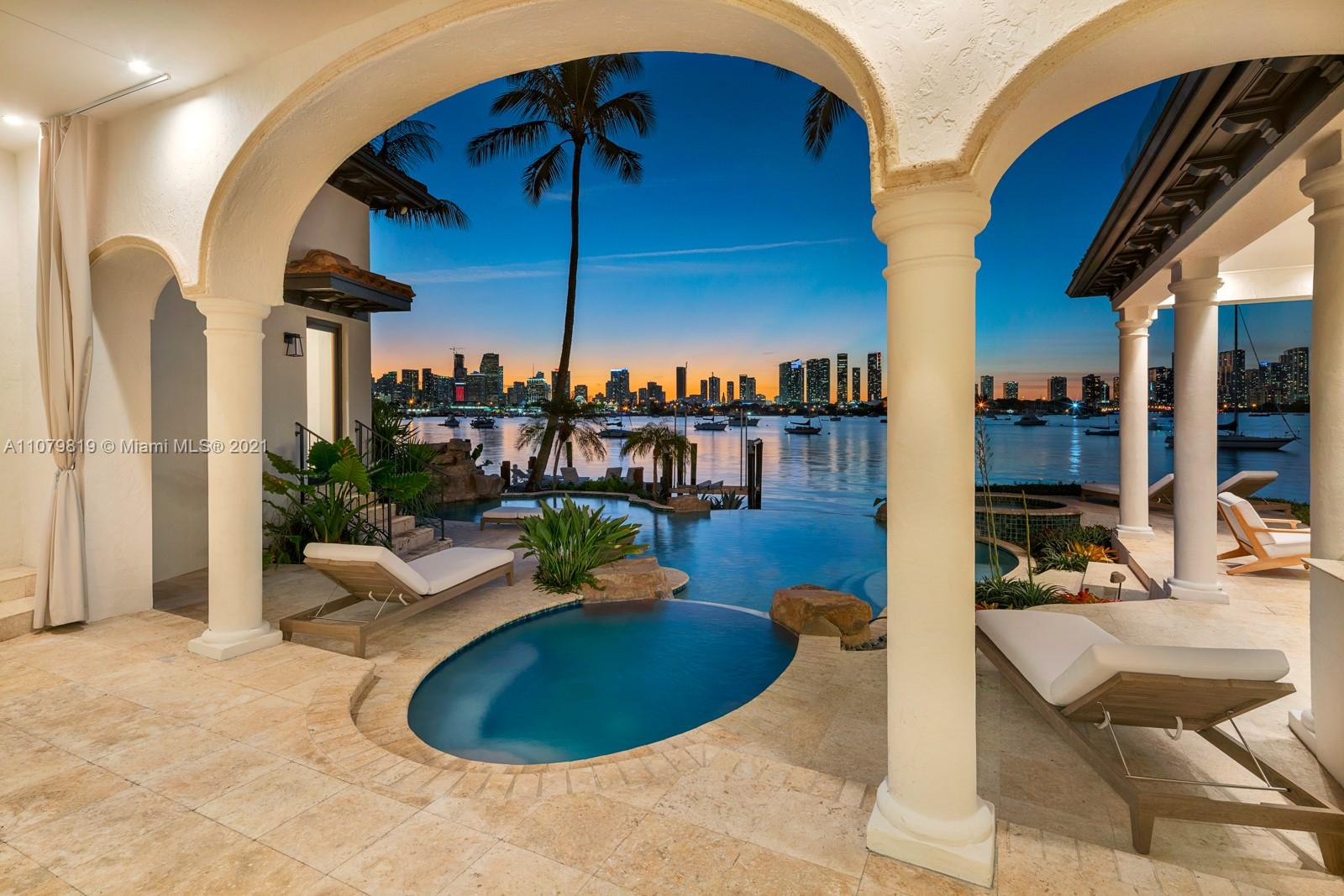 This one-of-a-kind Mediterranean estate is located on one of the most sought after plots on Hibiscus Island. The residence offers stunning panoramic views of ocean sunsets and the Miami skyline. The custom estate comes with everything expected from a luxury home such as superior construction, open spaces, top of the line finishes and spectacular views. The private dock w/ boat lift shares more than 125 feet of water frontage. The island is Police guarded and offers a basketball court, tennis court and children's playground.