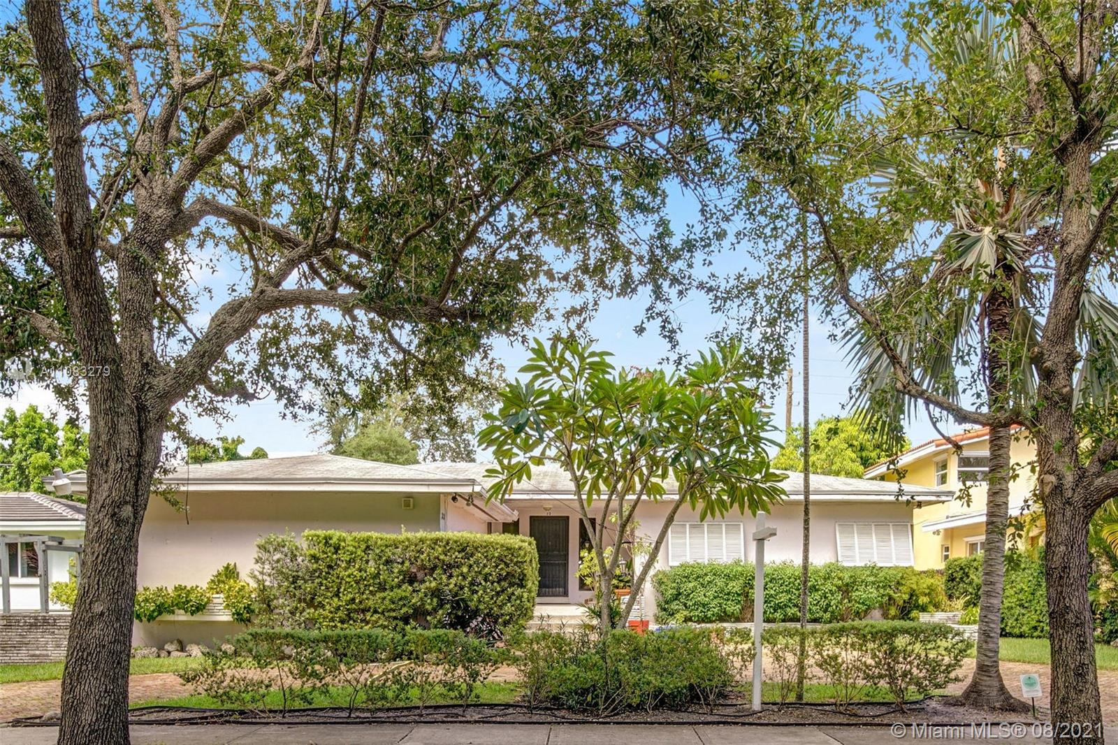 Terrific opportunity to live in Miami's most sought after neighborhood. Bay Heights is a jewel of an enclave within North Coconut Grove. Low traffic streets, wide sidewalks & lush mature trees. A neighborhood where kids still ride bikes and visit friends. This home is one of the few adjacent to the parcel owned by Vizcaya (the site of the former planeterium) which is being transformed into a nature preserve and greenhouse. No busy street, neighbors or noise behind you, Complete privacy and serenity, 24 hr roving patrol. This classic 50's ranch with it's terrific layout & oversized 9225 sq ft lot has potential to be a very special modern home.  Chicago Brick circular drive, 2 car garage. Not in flood zone yet walk to bay and Hobie Beach!  see Broker's Remarks for showing instructions.