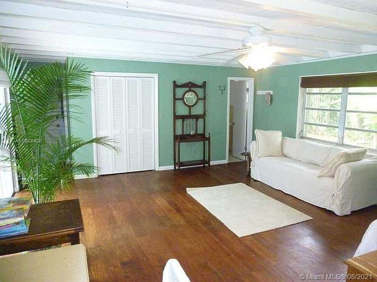 Rare find in high-demand N. Palmetto Bay neighborhood! Classic 1960's tropical-mod home complete w/ atrium patio entrance set on expansive, fenced 16,800 sq ft lot under a canopy of mature trees. Split plan w/ 3 bedrooms on one side & separate 4th bedroom that easily serves as an office/guest suite/in-law quarters. Remodeled kitchen, new A/C, laundry room w/ new washer/dryer, 2-car garage, new roof in 2015, accordion shutters throughout. 2 blocks from Howard Drive Elem, minutes to Pinecrest & Coral Reef Elementaries, Palmetto Middle/Senior and many magnet & private schools including Alexander Montessori, Gulliver, Westminster, Sunrise Waldorf & Palmer Trinity.Minutes to everything yet wonderfully private & peaceful. Move right in or personalize and polish to perfection.