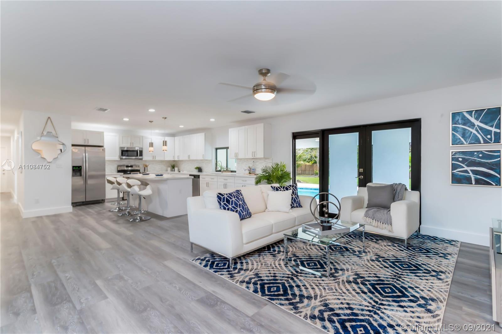 **OPEN HOUSE Saturday 9/18 11AM-1PM & Sunday 9/19 12PM-3PM**  Immaculate 5 bedroom 3 bathroom fully renovated, pool home in the highly desirable Palmetto Bay. This pristine, corner lot home sits on just under a half acre lot. Home features complete impact windows and doors, brand new roof, large kitchen and an open concept layout perfect for entertaining. Two large master suites with walk-in closets, split floor plan & spacious laundry room. Enormous backyard with plenty of space for an outdoor kitchen or future expansion. Recently resurfaced pool, brand new kitchen w/ SS appliances. New waterproof vinyl flooring, baseboards and freshly painted interior & exterior. Wonderful location & excellent school zone!