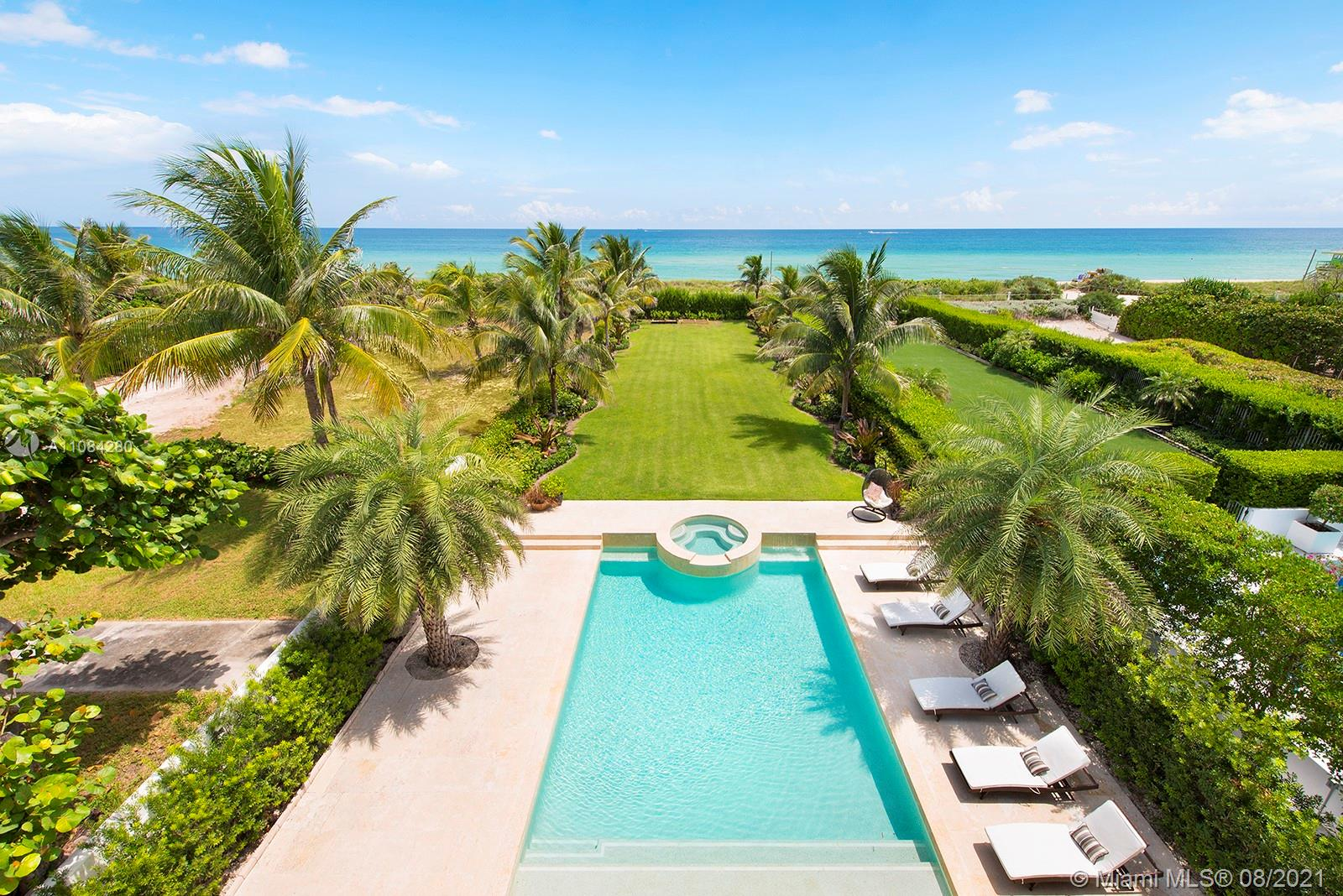 Start the day w/ a sunrise walk along the beach from private, guard-gated Altos Del Mar villa DIRECLTY ON THE OCEAN at highest flood elevations in Miami Beach. Turnkey opportunity with brand new furnishings & a Raymond Jungles-designed landscaped garden & rooftop terrace. 1st floor cabana kitchen & family room (plus two bedrooms) opens to covered loggia w/ summer kitchen & bar. Enjoy privacy in the infinity pool while guests lounge on grassy areas or walk a few steps to the beach. Enjoy views from 2nd floor master w/ private terrace, his/her master bath toilet rooms/sinks & three additional bedroom suites. Stunning vistas from 3rd floor kitchen, living, dining, & family rooms and seaside dining terrace. Two detached 2nd floor guest suites in 3 car carriage house for 7 parking spaces total.