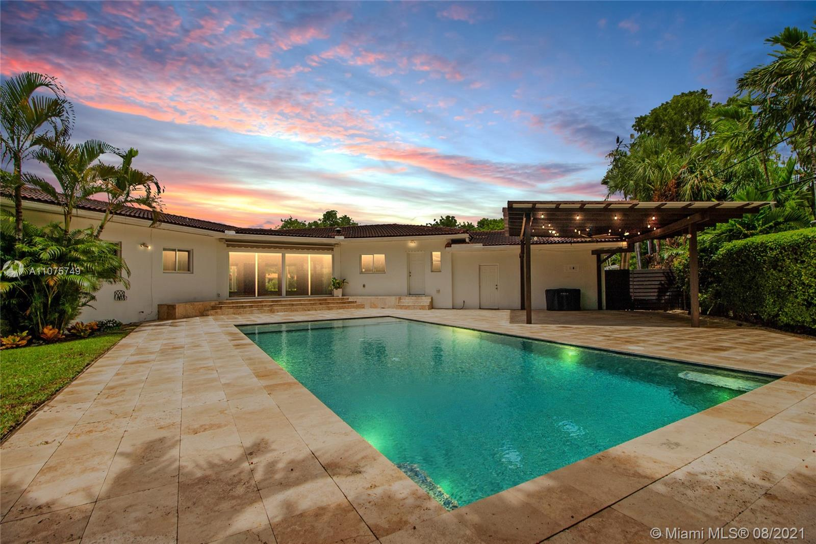 Bright and spacious 4 bedroom/4.5 bath residence with large heated pool and an oversized two car garage. This lovely house on a corner lot has 13,250 square feet of landscaped garden with a fully fenced backyard ideal for privacy and security. Property features a large outdoor entertainment area with a gazebo, open floor plan, impact windows/doors, 2 new a/c's, laundry room and hardwood floors. Sidewalks on each side of the street, 24/7 police patrol & no flood zone. Close to excellent private and public schools, waterfront parks, beaches, airport, downtown and Brickell area. Also available for short term rental.