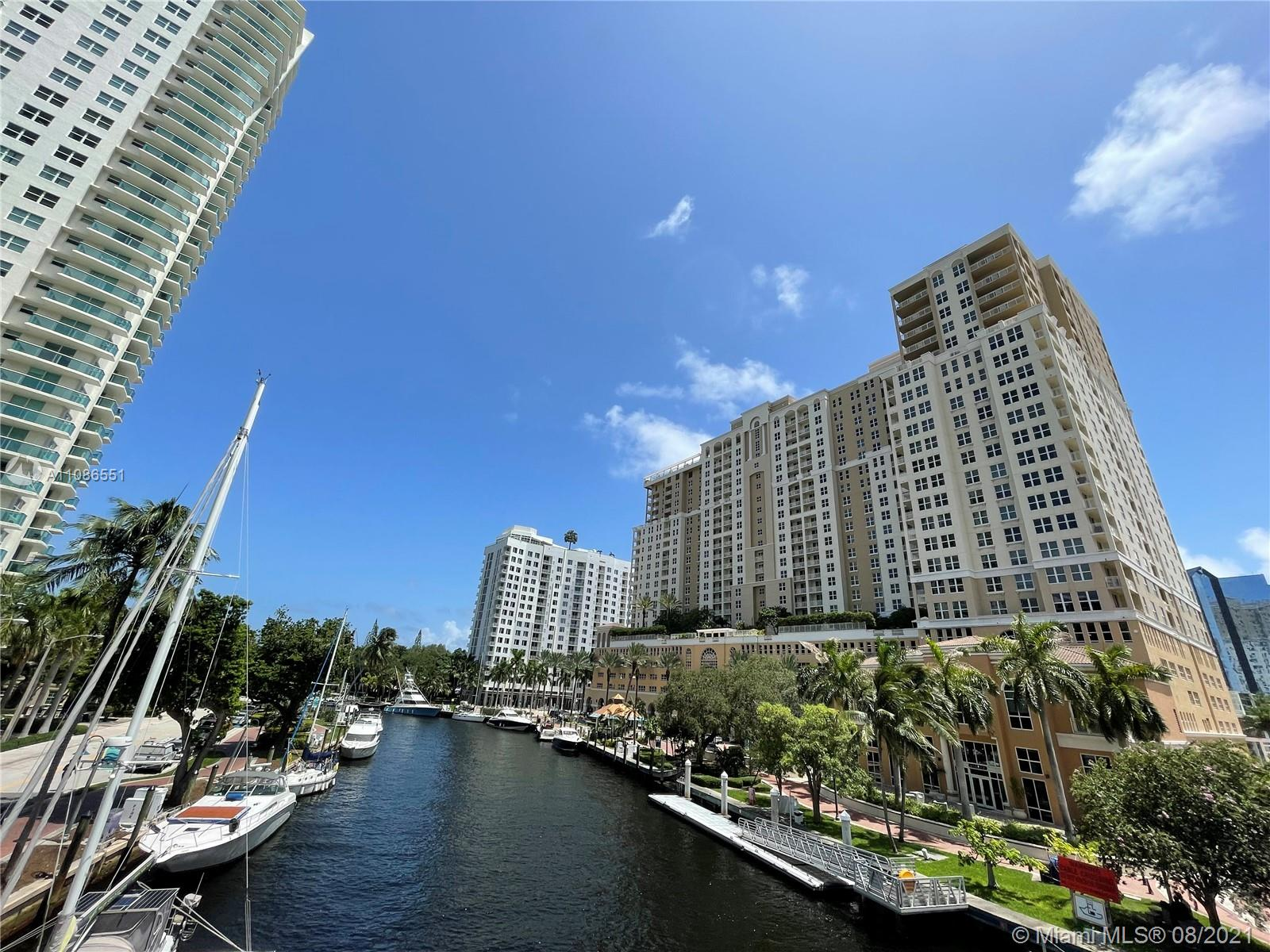 Located in the heart of Downtown Fort Lauderdale, this south-facing 2br/2ba boasts a spacious open concept floorplan with split bedroom layout and is perfect for entertaining. The kitchen features stone countertop/backsplash, modern Italian shaker style cabinetry and stainless steel appliances. The unit is smartly updated with engineered wood floors in both bedrooms, newer appliances, stacked laundry, new hot water heater and a large single basin kitchen sink with touchless faucet. Just steps from downtown, the 5 Star building amenities include: rooftop pool and Sky Lounge with panoramic views, 2 story fitness center with basketball and racquetball courts, 24hr front desk attendant, 24hr valet, His and Hers locker rooms with steam and sauna, business center and much more!