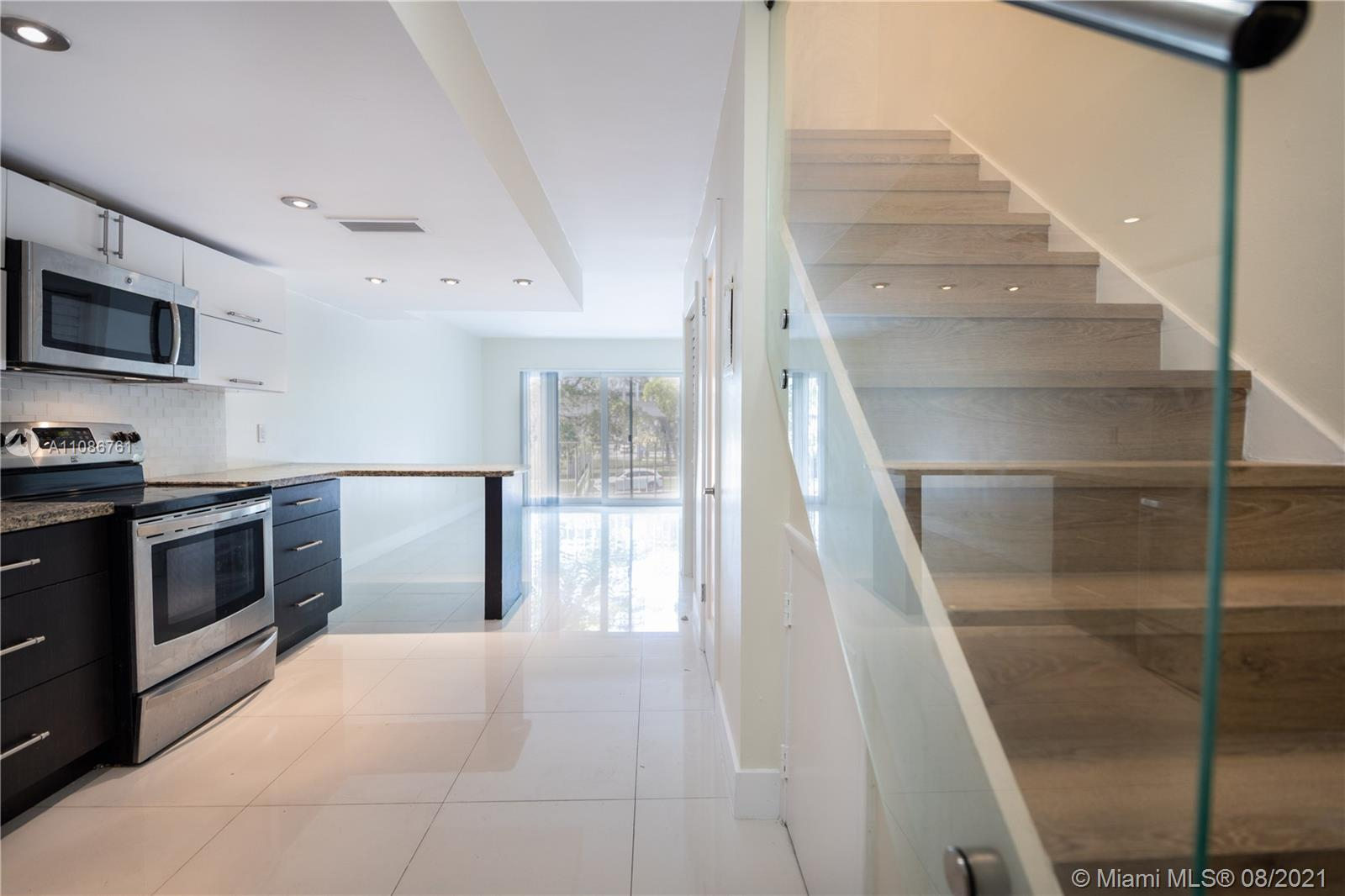 Completely updated 2 bedroom 2 story townhome located in the heart of Coconut Grove. This unit welcomes you with an open kitchen, modern tile floor, stainless steel appliances, dishwasher, garbage disposal, washer & dryer, 1/2 Bath, and spacious balcony. Enjoy the custom glass railings, custom wood stairs Both bedrooms located upstairs with master room having balcony access each. The fullpath separates both rooms and both closet. Building offers hurricane impact windows & state of the art security cameras. Apartment has 2 assigned parking spot and also offers street parking for guests. Minutes away from Cocowalk, University of Miami, Coral Gables, Brickell, Sunset Mall and much more!