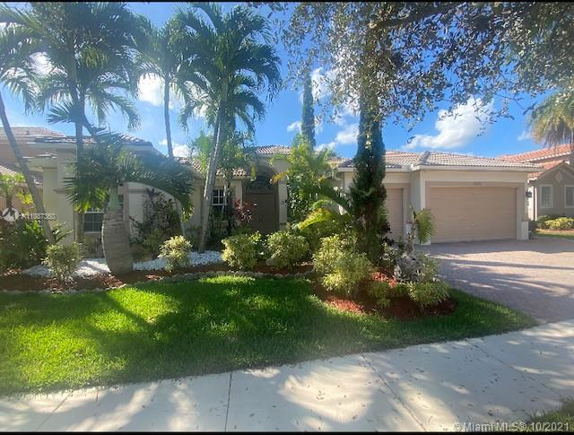 Elegant Lakefront/Pool with 24 hr guard-gated community of Isles At Weston.  Lushly landscaped serenity with deep and wide lake view, scenic pathways. Immaculately maintained, spacious 5 bedroom, 4 1/2 bath & 3 car garage with pool & spa. Master's suite with sitting room. Luxurious upgrades throughout the house featuring  modern  kitchen quartz countertop with large island and a dry bar. Stainless steel appliances with commercial grade porcelain tiles throughout the house. Private fenced backyard has summer kitchen with large patio overlooking the peaceful lake and beautiful garden areas. Hurricane shutter/impact protection. Walking distance from A+ schools. Clubhouse with gym, two pools, child playground and many more amenities.