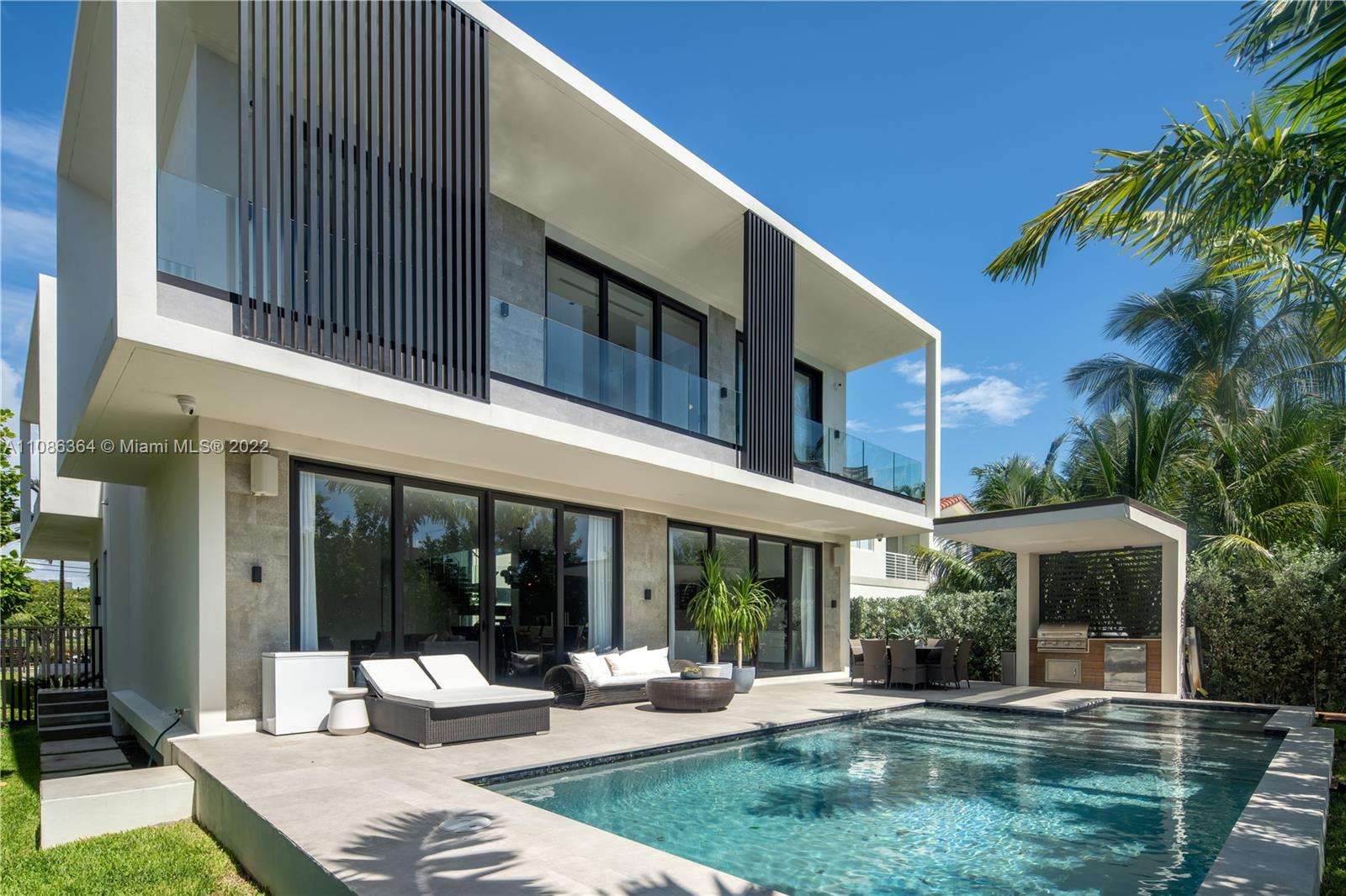 Modern waterfront living awaits you at this brand-new furnished 6 Bedroom, 7 Bath residence. The 4,614 SF home has an open floor plan, high ceilings and floating stair case, allowing light to flood in, reaching all areas of the living space. Italkraft chef's kitchen offers an oversized eat-in island with top-of-the-line appliances, ideal for entertaining. The Master suite features eastern water views, an incredible walk-in closet, & a bathroom with stand-alone tub, separate shower, & dual marble vanities. Swanky private pool, outdoor kitchen, large new dock and 62 feet of water-frontage beckons water enthusiasts. Centrally located to South Beach's restaurants and shopping minutes away.