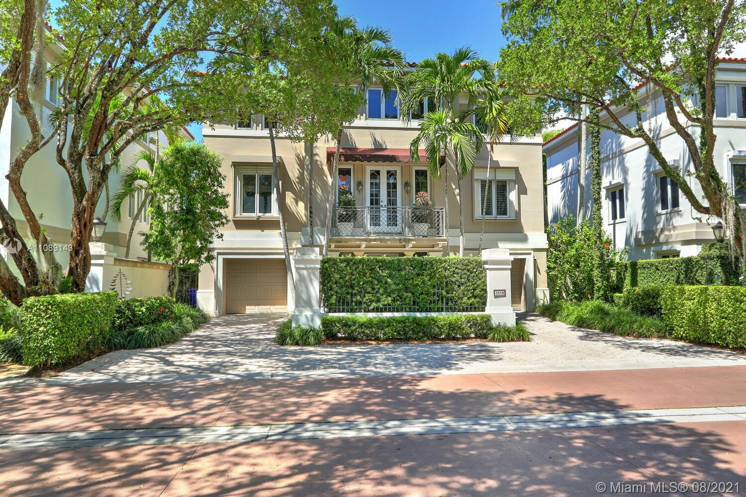 """Live in one of Coconut Groves most sought after gated community """"Bayshore Villas"""". A private enclave of only 25 residents one of the most beautiful, lushly landscaped streets on Coconut Grove. This 3 story villa has a fabulous floor plan 4 bedrooms, 4 baths with over 5,600 SQ FT of living space, office, bonus room, family/living/dining room and gorgeous master suite with beautifully built out spacious his & hers closets. Impeccably maintained home, freshly painted, impact glass throughout with extra storm protection (Electric shutters). Community pool/Spa, 2 tennis courts, docks. Best schools, parks, Coconut Grove Marinas, restaurants and shopping. Walk, jog or bike to the heart of Coconut Grove. Enjoy urban living."""