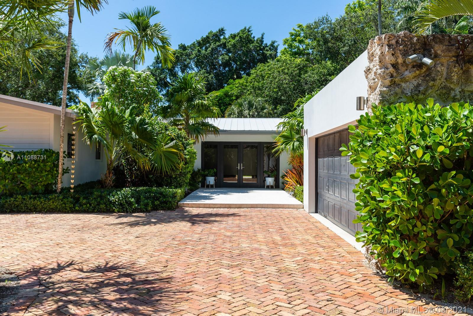 This is not your cookie-cutter Pinecrest home! A beautifully-renovated, 4 BD/4.5 BA, single-story home situated on a gated, lush corner lot on one of Pinecrest's most idyllic streets. With more than 3,800 ADJ SF, this home offers ample living spaces with an open chef's kitchen, generous patio + large family room/den that is perfect for a playroom, home office or flex space, complete with a wood-burning fireplace. While this home has all the modern updates (including smart home systems, renovated bathrooms, impact windows, a brand new hurricane-rated garage door, all Thermador appliances, newly-resurfaced saltwater pool, etc.), it also pays homage to the home's original charm with stunning terrazzo floors in the primary bedroom. This home is completely turnkey + ready for new owners.