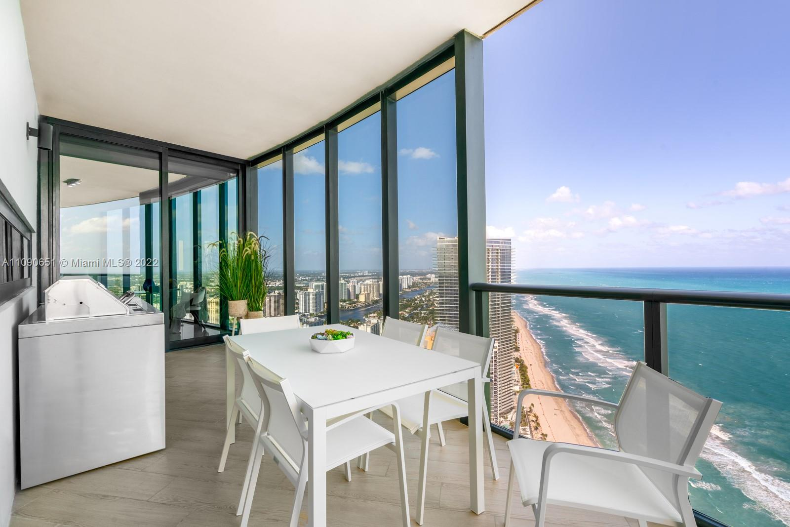 BEST UNOBSTRUCTED OCEAN VIEWS in the entire building! The only building you can drive your car into your apartment with a 2 car sky garage. Soaring 51 stories, this 4 bedroom mansion in the sky comes completely finished with marble floors, automatic blinds, smart home system, high end closet finishes, marble bathrooms, TOTO smart toilets, service room with brand new washer and dryer and service bathroom, a summer kitchen, pool on the balcony, 2 car garage in the unit, Poggenpohl kitchen with marble countertop and Miele appliances, a large dining area, and unparalleled panoramic views from every single room. Don't lose the opportunity to own the best placed residence in the most private, exclusive, and luxurious building Miami has to offer.