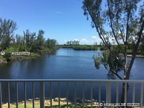 Beautiful condo in Saga Bay Gardens! Features 2/2 split plan, tiled flooring, balcony overlooks the lake, unit is located on the 3rd floor, building has elevator access, gated community with card entry, covered parking for 1 vehicle, 2 assigned parking spaces total. Association has reserves! Must see!
