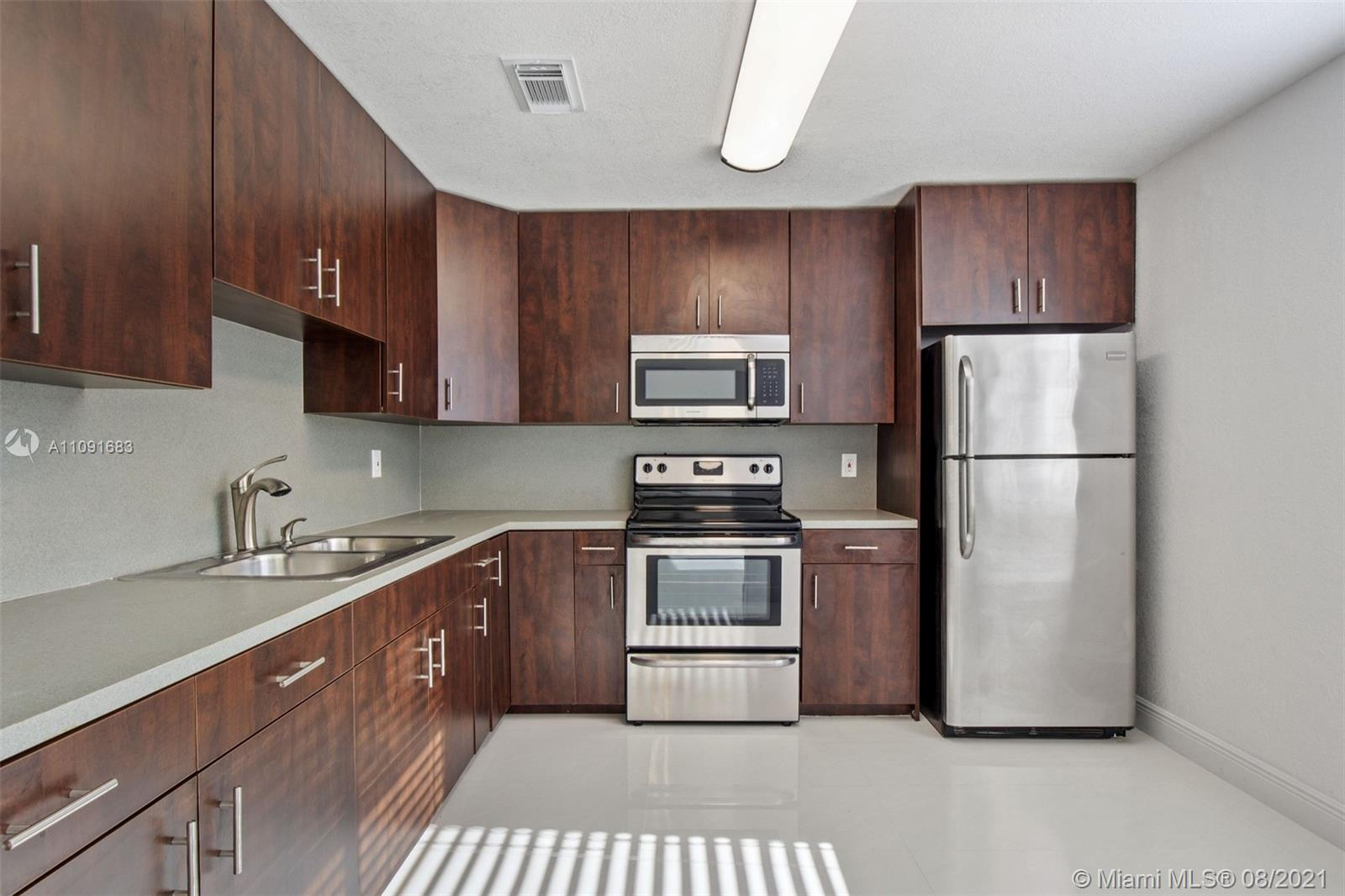 Beautifully remodeled unit. 3 bedroom 2 and a half bathroom. This unit is completely updated with tile throughout the first floor and wood-like floors upstairs. Very spacious and clean. The first floor has a large laundry room with plenty of space for storage, updated half bath, living room, dining area, and updated kitchen with stainless steel appliances. Walk out to a nice, low maintenance patio, perfect for entertaining. The 3 bedrooms and 2 baths are located on the second floor. One assigned parking spot located directly in front of the unit and plenty of guest spots close by. The unit is located close to the bbq/picnic area, playground, tennis courts, and pool. This unit will not last.
