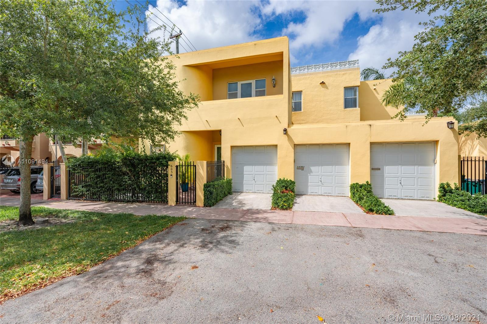 Welcome home to this one of a kind located in the heart of Coral Gables. Beautifully updated Art Deco townhome nestled on the quiet Segovia street. Walking distance to Merrick Park, The Miracle Mile, Venetian Pool, Granada Golf Course, and more so that you can enjoy neighborhood walks and entertainment. Featuring 2 bedrooms and 2.5 bathrooms, one space in a shared 2 car garage, and a bonus den not counted in the square footage on record (actual sqft is 1795) which can easily be used as an office, gym, or playroom! Entertain guests in the screened patio or the lush shared garden. Modern fixtures and impact windows and doors make this a truly turn-key home. Washer/dryer in-unit.