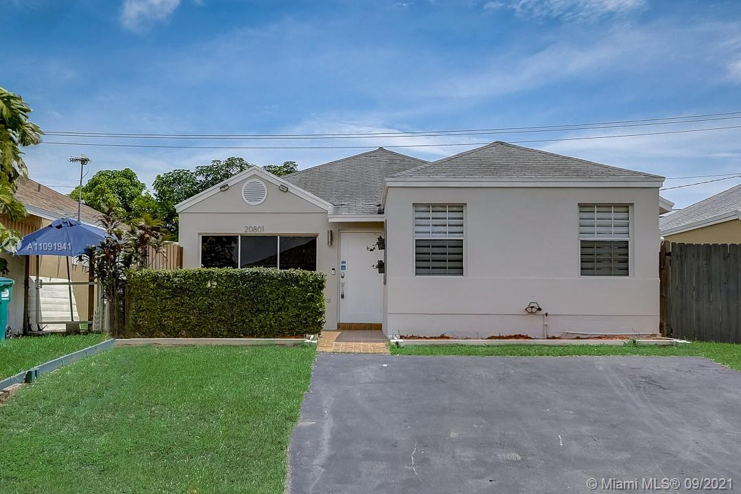 This Cutler Bay one-story home offers quartz countertops.
