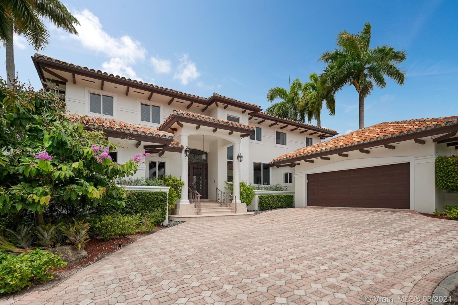 This beautiful 6 bedroom 5 1/2 bathroom Mediterrenean style home is located in one of Coral Gables most sought after gated communities Islands of Cocoplum. The home sits on a quiet cul-de-sac with backyard access to the clubhouse, gym, basketball courts, pool & childrens playground. Other amenities include guardhouse w/ gated entry, 24hrs security, patrols, first class lighted clay tennis courts & volleyball court. New kitchen w/ viking appliances, large island & eat-in kitchen opened to family room with spectacular view of terrace with pool & built-in grill. 2 bedroom, 2 1/2 baths & laundry room located on 1st floor. Large Master bedroom w/ sitting area & spa-like bathroom. Formal dining & living room with wet bar & wine cooler for entertaining. A truly great family home!