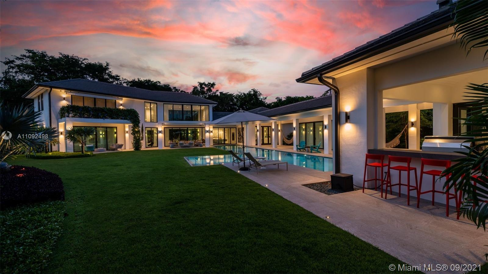 A true one of a kind two story 8,958 sqft Estate in the heart of the Gables. This incredible newly custom built Trophy property is nested on an oversized 25,989 corner lot and surrounded by lush tropical gardens. With a dramatic 23 ft ceiling living room the entire estate has elegantly and meticulously been designed with countless details a sophisticated finishes. this 6 beds/7.5 baths has a state of the art office, gym and private spa w/ sauna & Steam room and semi-olympic 25m  pool and every single feature any exigent buyer could search for. Perfect for entertaining this L shaped property is the perfect harmony between in and outdoor living and custom electric roof, an extraordinary gourmet custom kitchen w/ top of the line appliances,wine cellars,4 Cars indoor garage and full smart home