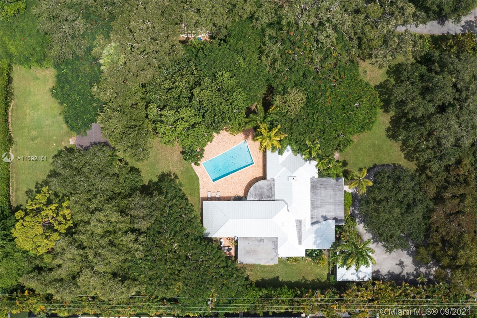 Don't miss this rare opportunity to build or expand on a deep 1.14 acre lot in prime Northeast Pinecrest where homes currently for sale on similar lots average over $9 million. Walking distance to Gulliver Prep and just minutes from Beth Am, Our Lady of Lourdes Academy, St Thomas, Pinecrest Elementary, and great shopping and restaurants in South Miami and Dadeland. A similar property across the street recently sold for $3.2 million in just 17 days, and the least expensive home currently for sale in Northeast Pinecrest on 3/4 of an acre or more is $4.95 million so don't miss this chance to own over an acre in one of the most exclusive neighborhoods in Miami.