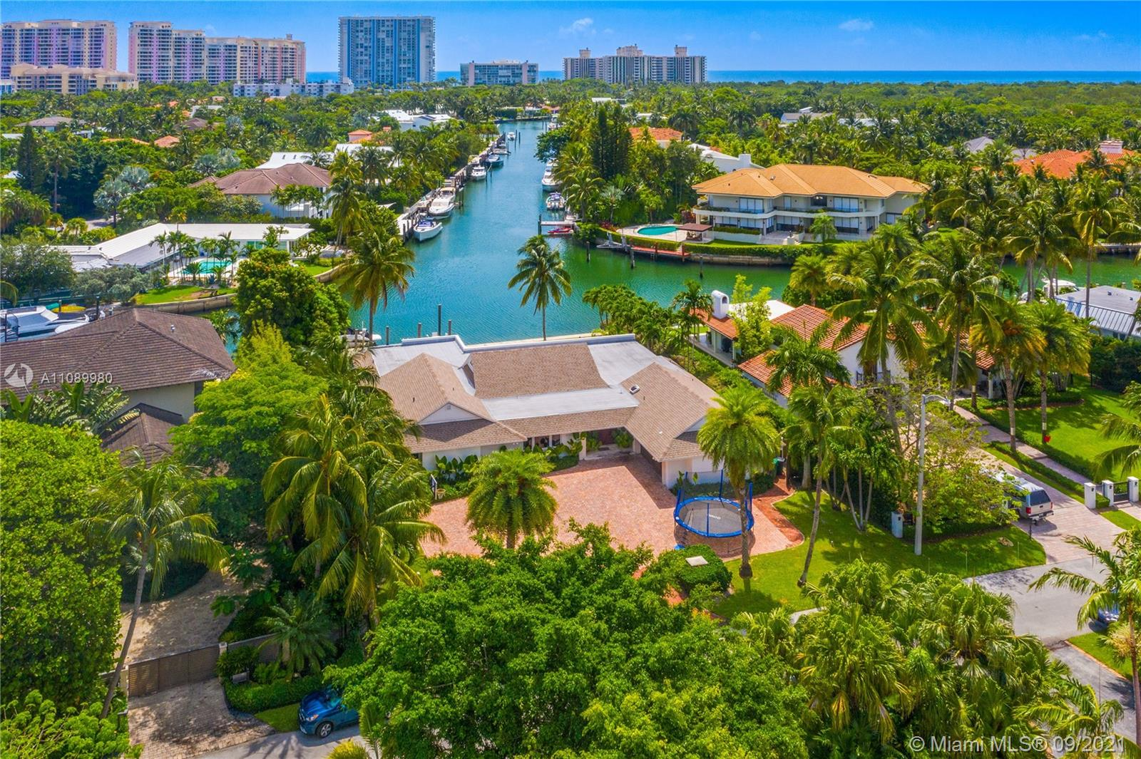 """Incredible location in one of Key Biscayne's most desired streets … """"Mariner Drive"""" which is private, quiet, secure and one of the highest streets on KB with 15,893 Sq Ft of land.  A true yachtsman's paradise with over 100 feet on the water and amazing endless views down the canal with easy access to the bay.  This one story residence is open, bright and has natural light throughout with high ceilings in the living area.  Offering 5 ample bedrooms, 4 bathrooms, 1 cabana bath, office, separate living and dining room, spacious family area, garage, dock, and an oversized gorgeous infinity pool with a great terrace for those who like to entertain.  Rare opportunity to own this magnificent property which is all about location. Tenant occupied until February 2022. (see broker remarks)"""
