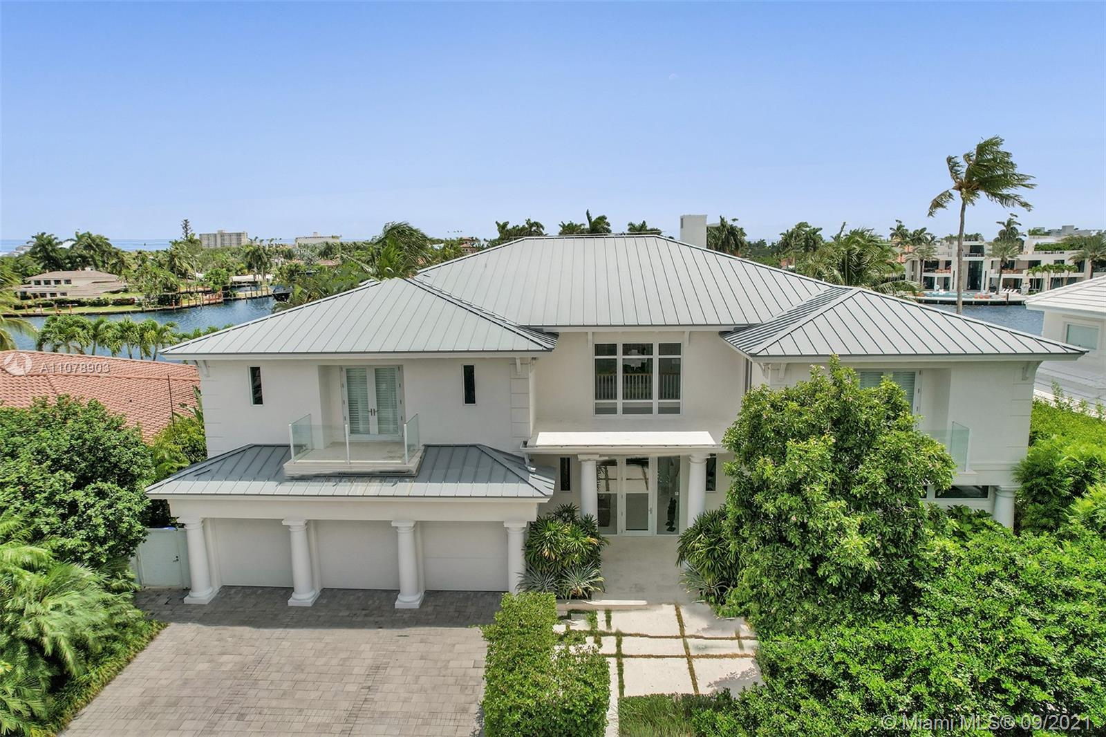 Stunning waterfront estate located in the unique island community of Sunrise Key consisting of 75 single family waterfront homes w/ gated entry & police patrol. Breathtaking wide water views ideal for boating w/ a large turning basin in the no wake zone Rio Barcelona waterway & minutes to the Intracoastal w/ no fixed bridges. Luxurious custom appointments w/ modern framework including all en-suite bedrooms, chef's kitchen w/ butler's pantry, top of the line appliances w/ custom commercial range hood, floor to ceiling windows w/ electric window treatments, tray ceilings, custom oak built-ins throughout, oversized laundry room, 3 car garage, back staircase to 2nd floor, lush landscaping & many more custom features.  First time on the market. Property is offered furnished. Artwork negotiable.