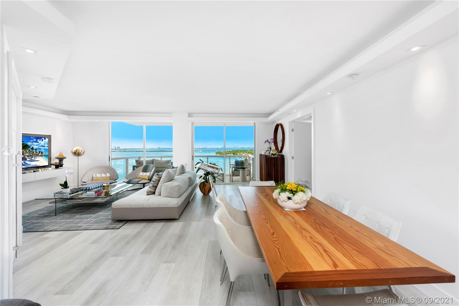 Embodying the definition of timeless and modern sophistication, with no expense spared, experience this 2-bedroom 2-bath unit at the Grand Venetian with unobstructed stunning views of Biscayne Bay. This smart-home enabled unit also features white oak flooring throughout, top of the line kitchen appliances, Quartz counter tops, custom doors, 2 balconies and floor-to-ceiling glass sliders throughout for seamless indoor/outdoor living. The Grand Venetian is a luxury boutique building with Valet Parking, Concierge Tennis Courts, Gym, and a recently renovated Pool and BBQ/Bar area.