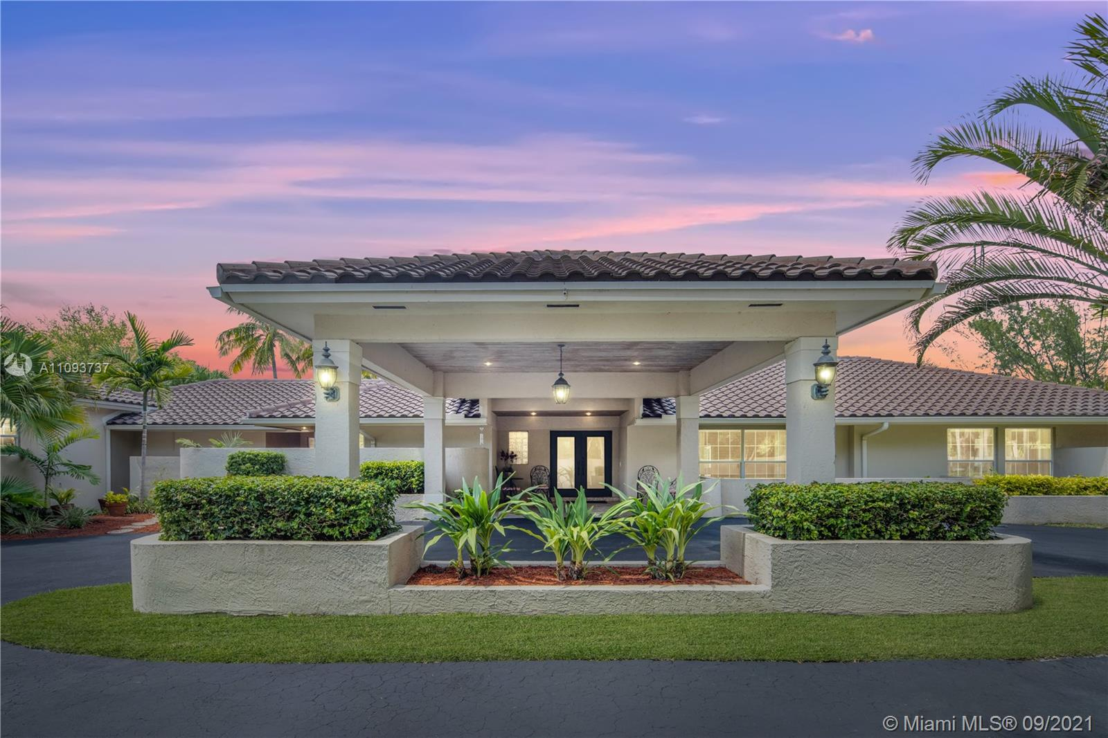 Welcome to Palmetto Bay! Private schools neaby. This 6,000 sqft estate has 5 bedrooms and 5 bathrooms, on approx. 38,000 sqft gated lot. New barrel tile roof installed in 2019. Backyard has saltwater pool and spa, gazebo with kitchen, and full bath. Spiral stairs leads to rooftop sundeck. Interior has marble flooring, large game room, sunroom, vaulted ceilings, 2 family rooms, 2 dining rooms, and stone fireplace. Kitchen opens to the family room and has island, bar, and granite countertops. The master suite has direct pool access, a private lanai patio, and hardwood flooring. The master bath has a jet tub, his and hers marble sinks, and lots of natural light. Enclosed outdoor terraces off bedrooms. Laundry room has backyard access. Extra parking for boat and toys. No flood insurance rqmts.