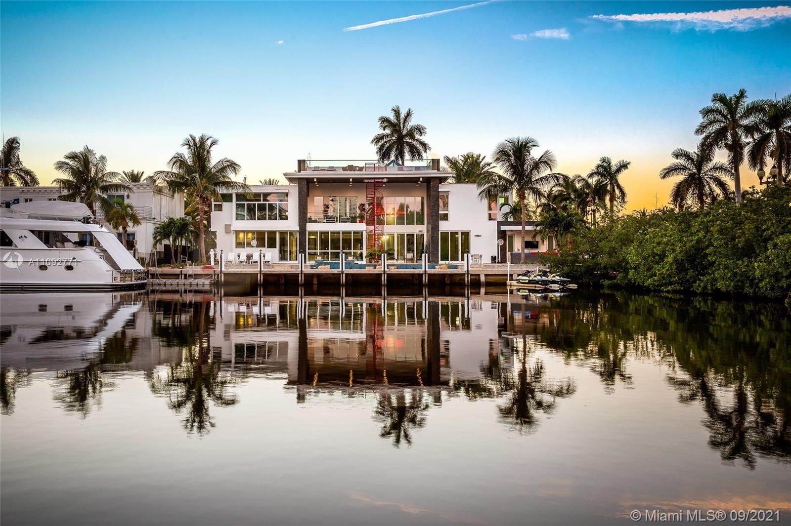 This luxurious and stunning property has 7 beds and 7.5 baths along Las Olas. This gorgeous home was designed with modern luxury in mind and has Italian furniture throughout the interior. With a top-of-line chef's kitchen, gas fireplaces, an elevator, a pristine theatre room, and beautiful ceramic white flooring. This estate comes with access to the intercoastal with a large dock that can accommodate any size vessel up to 90'. This home is within walking distance of restaurants and the beach. This home is the most luxurious property offering all the modern features of impact windows, motorized blinds, multiple ac units, two stoves, and a dishwasher. Outside you can enjoy breathtaking views along the outdoor oasis with a beautiful rooftop deck with artificial grass.