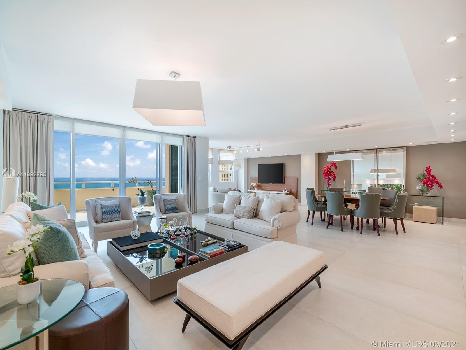 Masterful and modern luxury are uniquely embodied in this 3 bedroom, plus office and  4.5 bath Penthouse with 3,820 Square Feet plus 410 Square Feet of full size balconies boasting  stupendous views of the beach, the Sunrise and the Sunset. This one a kind home was redone with the top most luxurious finishes. Ocean views, bright accents and light pours into every room! Every detail was carefully selected. Highlights include light, sound and shade systems, marble bathrooms, marble flooring, artwork display lighting, and top designer wallpapers throughout. This property also includes  a separate Staff/ In laws Suite located in the building's first floor plus 2 assigned garage spaces and a Storage unit.