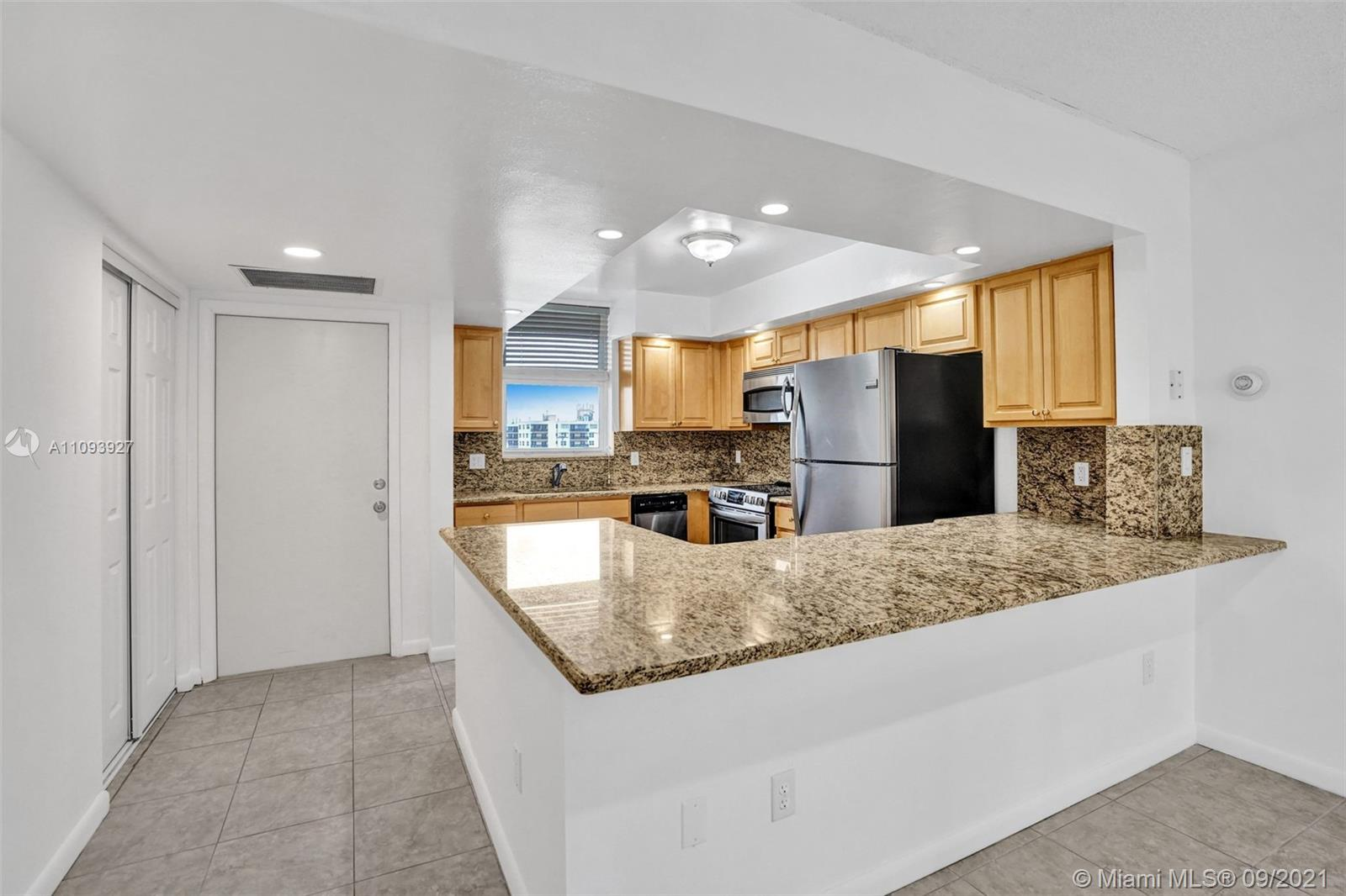 """Enjoy Wonderful, Ocean, Intercostal, & Ft. Lauderdale City Views, from this 2/2 Renovated Sub Penthouse Condo at """"The Royal Mariner"""". Walk to Lauderdale By The Sea Beach w/ Great restaurants & Shops! Renovated kitchen w/ Granite, Maple cabinets & S/S appliances, including Frigidaire Gallery refrigerator, w/ ice maker, GE Profile Convection Microwave Oven, Frigidaire slide in range, & dishwasher, Tiled throughout, & Walk in closets in both bedrooms, New Granite bathrooms, Pool, Club room & Garage parking for 1 car. This unit will sell FAST!"""