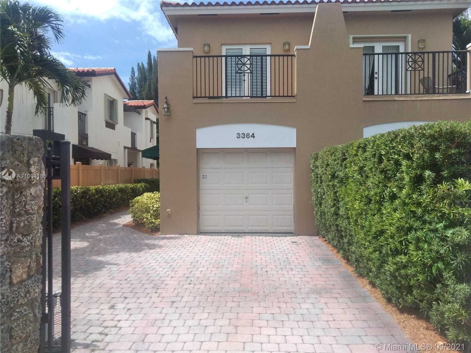 Grove lifestyle on the edge of Coral Gables. Executive TH built in 2005.  Large master suite has lavish bath with walk in shower, jacuzzi tub, bidet & 2 sinks.  2 other bedrooms upstairs + full bath,  laundry room (new washing machine).  Cook's kitchen with black granite counters, Bosch stainless appliances, desk area and 2 pantries. Liv room/separate din room and family room leads to newly fenced backyard with wood deck for Fla entertaining. Every room has lots of light with a french door opening to small balcony. Alarm, 1 car garage, electric front gate.  Brick front driveway large enough for 2 cars.  Douglas Park nearby. Close to Metrorail, Bascom Palmer, Mercy Hospital.  Minutes to A/P, Gables/Grove nightlife and business districts.  Dog ok with deposit, no more than 30 lbs.