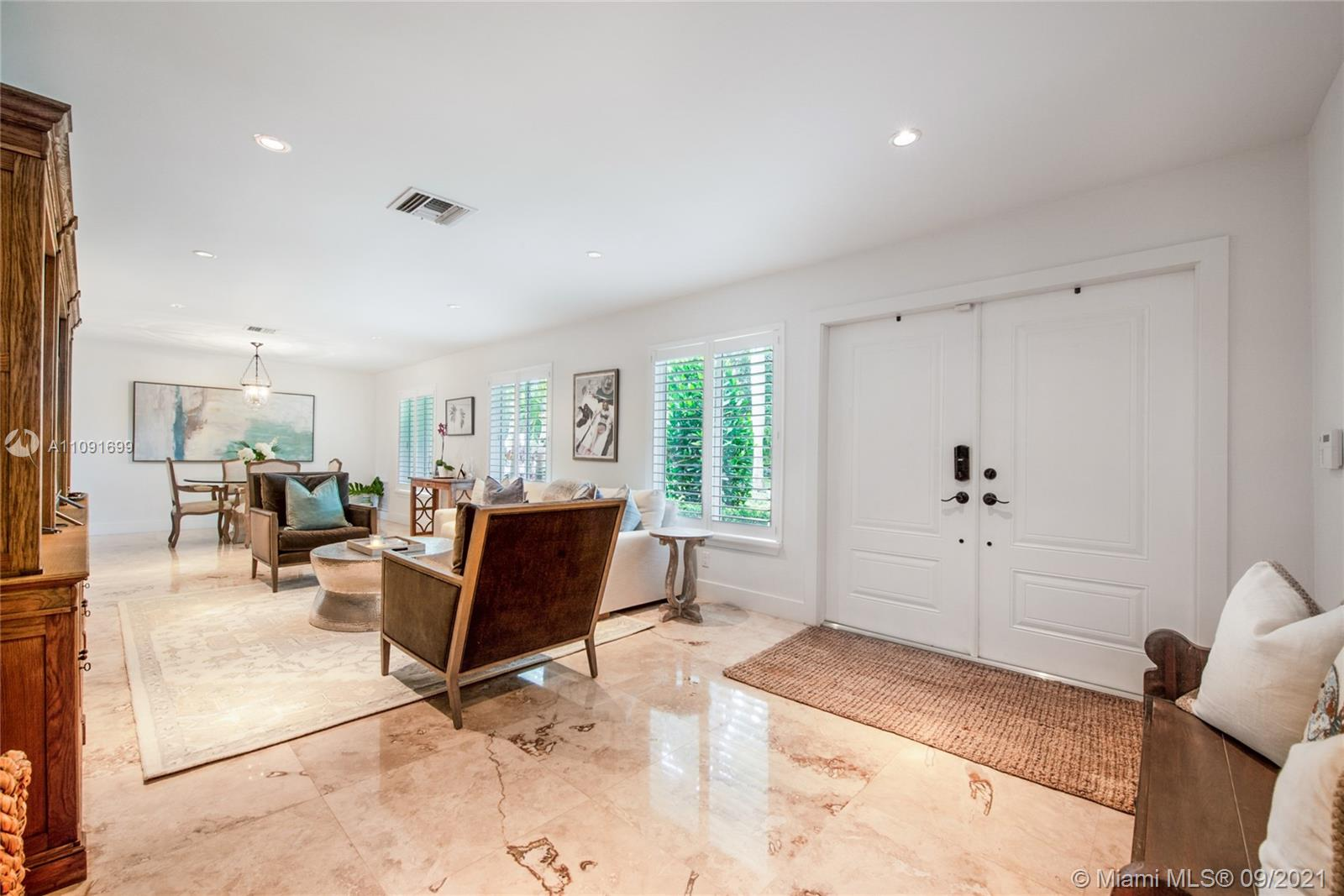 Yes, indeed, it IS all about location! But what about luxury and value?! It's all here! Outstanding 1-level residence in North Pinecrest that has been fashionably updated and now ready for the next family to take over the reins. Just one block north of Coral Pine Park and one block south of Royal Palm Tennis Club. Lots of goodies here including radiant marble floors, impact windows/doors, bespoke closet systems, custom built-ins, 3-year old roof, dual-zone A/C and a glorious verdant, private lot with plenty of room for a pool. Pinecrest Elementary district. Floor plan is available. Priced for a swift sale!