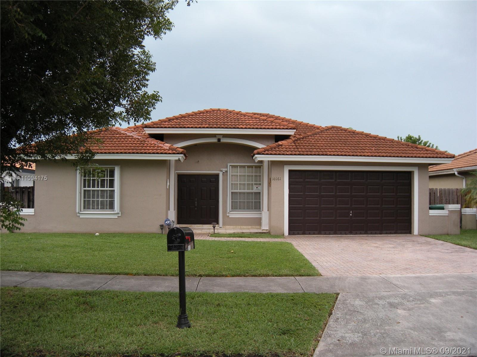 Located in the highly desirable Garden Hills community 2 minutes away from the West Kendall Baptist Hospital, shopping centers, restaurants and great schools. One of the few communities in the Hammocks/Forest Lakes area with no Homeowners Association. Large premium 60 X 134 lot ready for a sparkling pool and a Tiki Hut, 18 X 18 Brazilian Porcelain Tile throughout, high ceilings, attached 2 car garage with garage door opener, formal dining room, family room, new accordion hurricane shutters in all windows and doors, special touches throughout, walk-in closets, master bedroom with full bath and 2 closets, central AC, newer exterior paint and more.