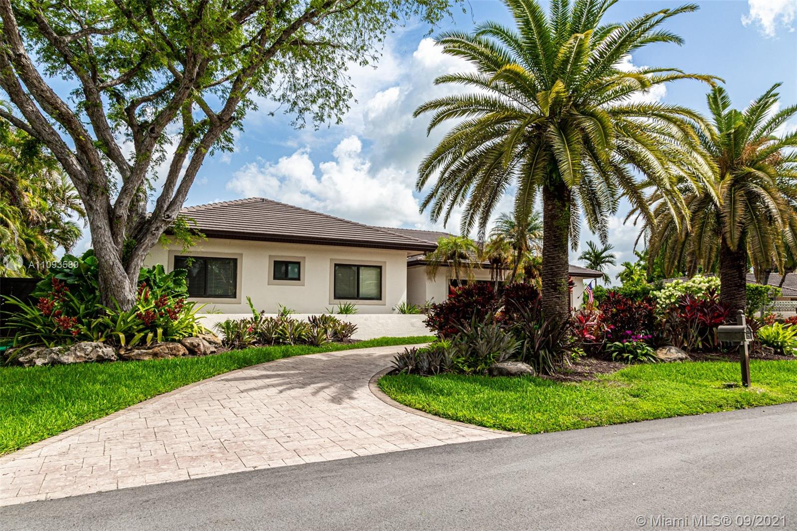 Enjoy this stunning home on a quiet cul-de-sac in Palmetto Bay!. Brand new tile roof and impact windows. Beautiful high ceiling, 5 large bedrooms, and 4 bathrooms, one of them with access to the pool area. This house offers the ideal layout, formal dinner, comfortable living areas, open kitchen, oversize master bedroom surrounded by a view of the pool. Great screened pool area with lush landscaping and a salt/water pool. New and upgraded electrical panel. 2 car garage.