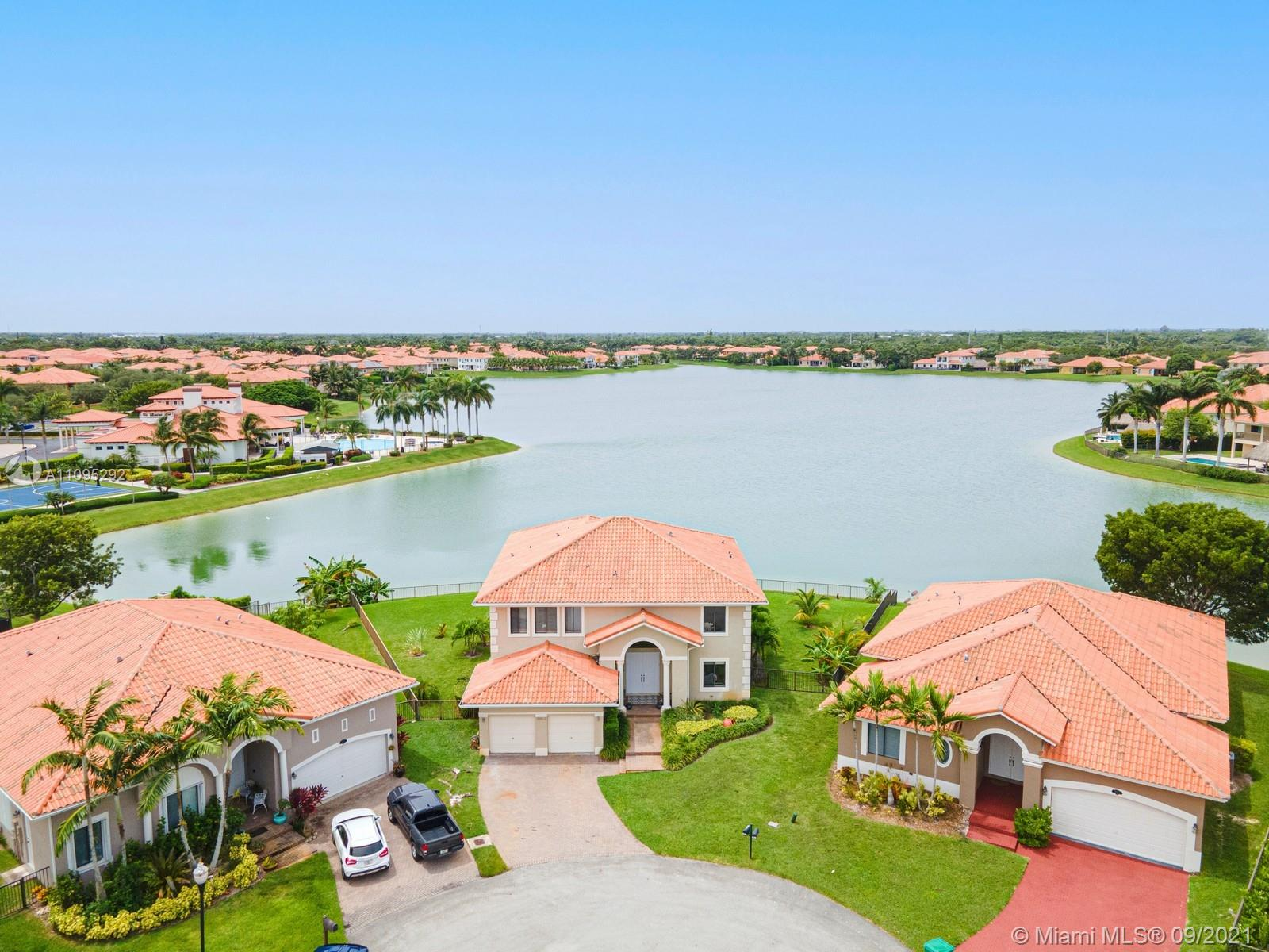Rare opportunity to own a lakefront paradise in the gated resort style community of Cutler Cay. This spectacular 2 story home offers 5 beds, 4/1 baths, high volume ceilings, and breathtaking lake views from almost every room of the home. The home includes several elegant updates throughout, including the kitchen and bathrooms. Ground floor has 1 bedroom with a full bath, upstairs is the Master Bedroom with additional 3 Bedrooms. Master Suite includes a seating area, large walk in closet, 2 smaller closets, 2 bathrooms, & stunning lake views from the large balcony and from your tub. This is your chance to wake up to water views everyday! Located on a cul-de-sac just a short walk away from the Prestigious Clubhouse which includes, gym, heated pool, playground, tennis and basketball courts.