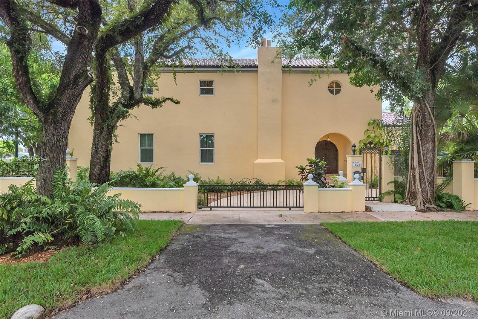 This beautiful Tuscan Home located near The Coral Gables Water Tower. It sits on a corner lot of .25 acres, blocks from Dade's highest point (no flood insurance ), a new roof completed in 9-1- 21 Warranty 12 yr.. Its quality construction is evident in the outstanding appointments of high ceilings & high arches giving it an air of grandeur, embraces an old-world look with all the modern amenities, emphasizing windows & exterior doors (all impact) that flood the interior spaces with natural light, while maintaining a privacy,oversized private tropical garden with many fruit trees (mangoes, avocados, bananas, etc.),flowers, lovely garden of various herbs. With space for a pool, four blocks from the Coral Gables Country Clubs. the gorgeous Venetian Pool available to all Coral Gables residents.