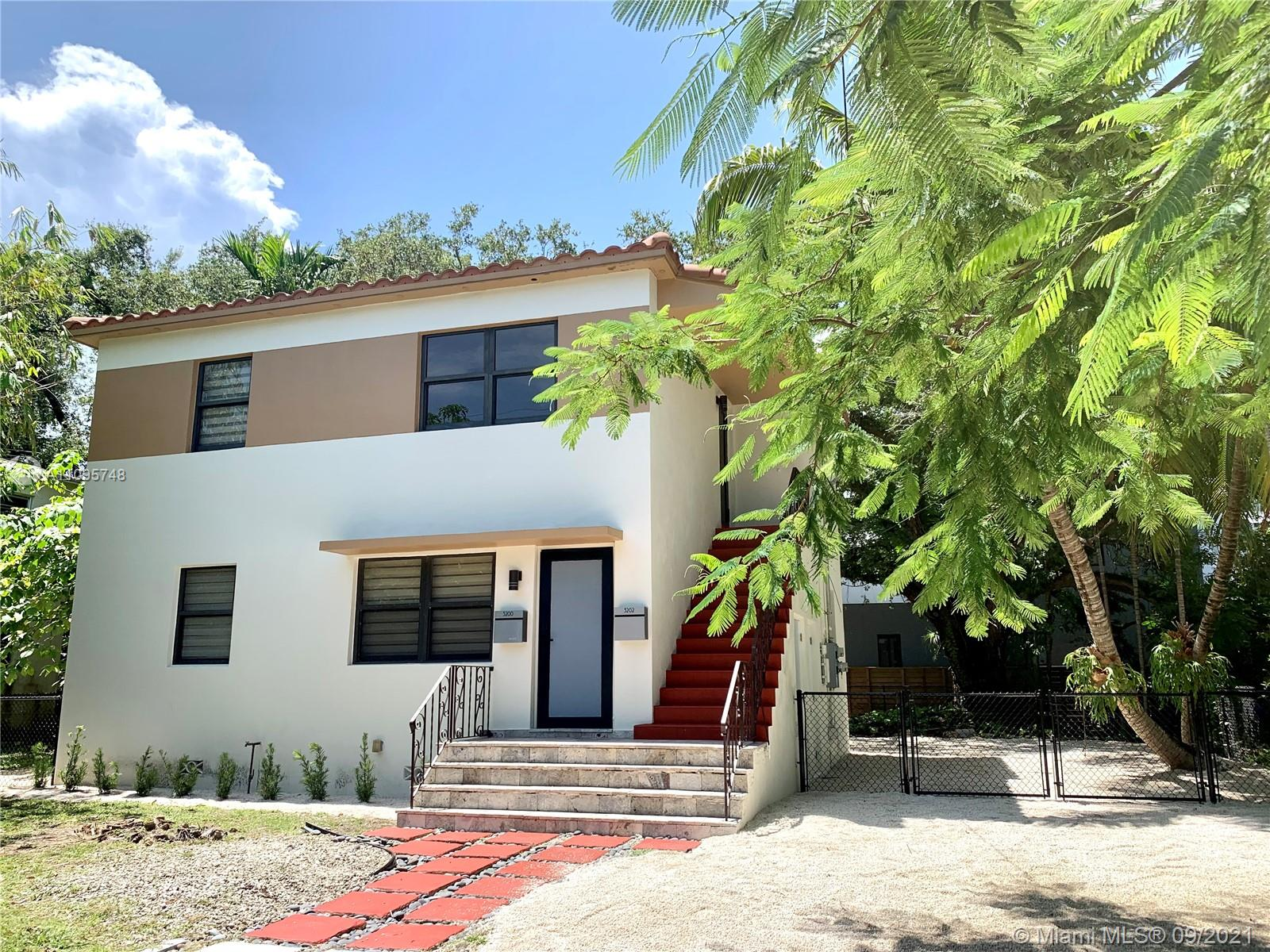 Peaceful & pristine Coconut Grove 1st floor garden duplex unit framed by towering oaks and lush tropical foliage. Impact windows shine light in from all angles, hardwood floors, updated kitchen & bath, brand new appliances, freshly painted inside and out.  Huge fenced yard, 2 parking spaces PLUS guest parking, separate laundry room services both units. Pet friendly. Walk/stroll/ride to all the Grove has to offer, a few blocks from shops, entertainment, restaurants, the waterfront, marinas & more!