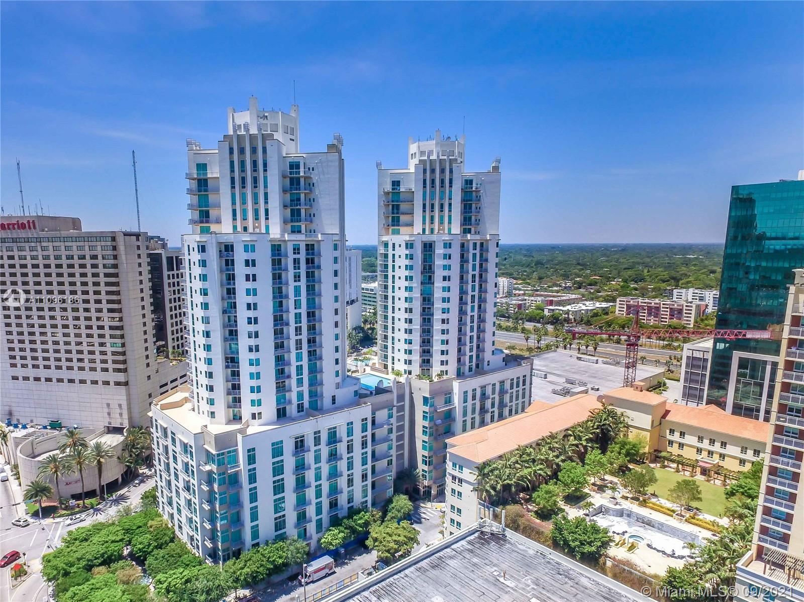 Don't miss the opportunity to own a brand new never lived in penthouse on the 24th floor in Metropolis at Dadeland.  This unit features marble floors, never used stainless steel appliances, wood kitchen cabinets with granite countertops.  13' ceilings with floor to ceiling double sliding doors lead you to a wraparound balcony with spectacular views of Brickell, Key Biscayne and the bay.  With 2 parking spaces, building offers two pools, jacuzzi, sauna, club room, fitness center, 24 hour concierge and valet service.  Walk to Dadeland Mall, metro station and all the up-and-coming restaurants.