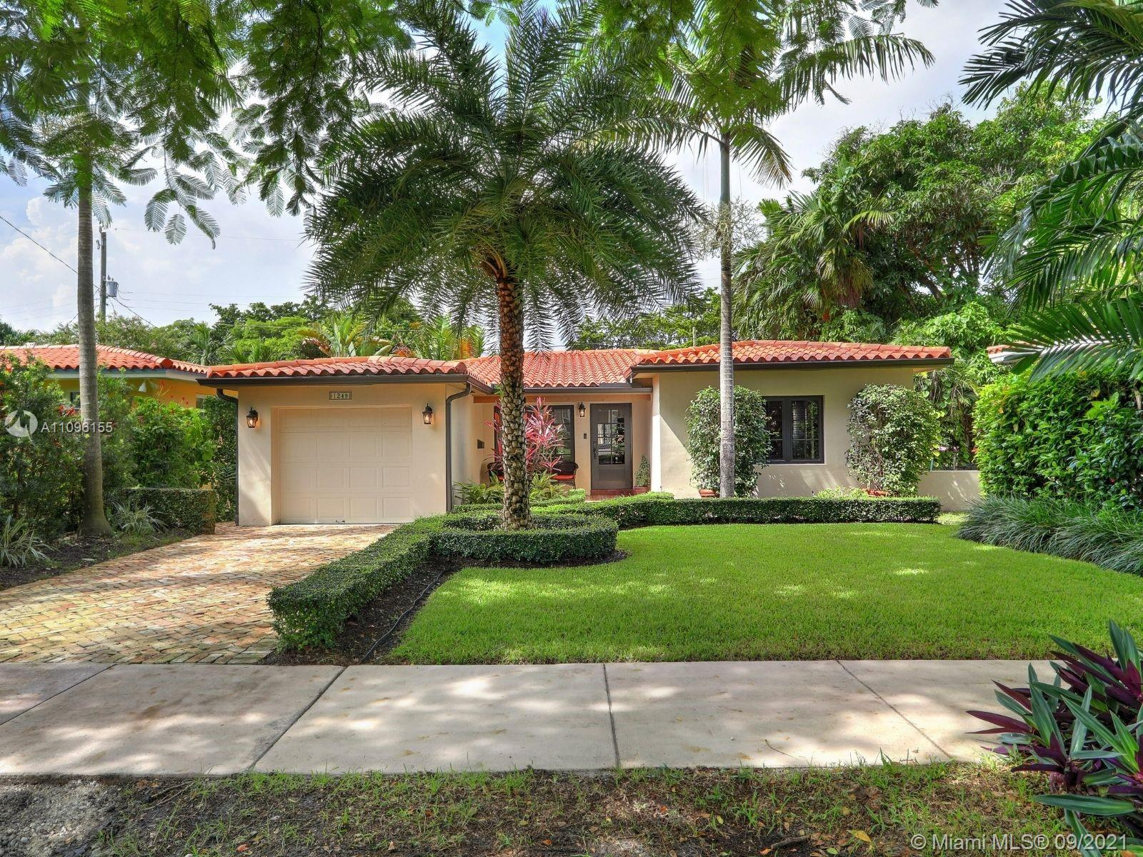 """Calling all those with discerning tastes and an appreciation for details. This charming Mid-century beauty is looking for a new owner to call her """"Home"""". Located on a lightly-traveled, Coral Gables tree-lined street, the meticulously-kept property features an enchanting entrance with a Chicago brick-paved walkway, an inviting front porch with handmade Cuban tile and tongue-n-groove ceilings, a great open floor plan with 1,448 sq ft, 3 beds and 2 baths, bright social areas with large window openings, 1-car garage, and too many updates to list. Come for the Italian tile flooring, recessed lighting, open kitchen, and exquisitely updated baths. Stay for the upgraded electrical and plumbing, neatly-manicured landscaping, impact-resistant windows and doors, and more! Call us to see it today."""